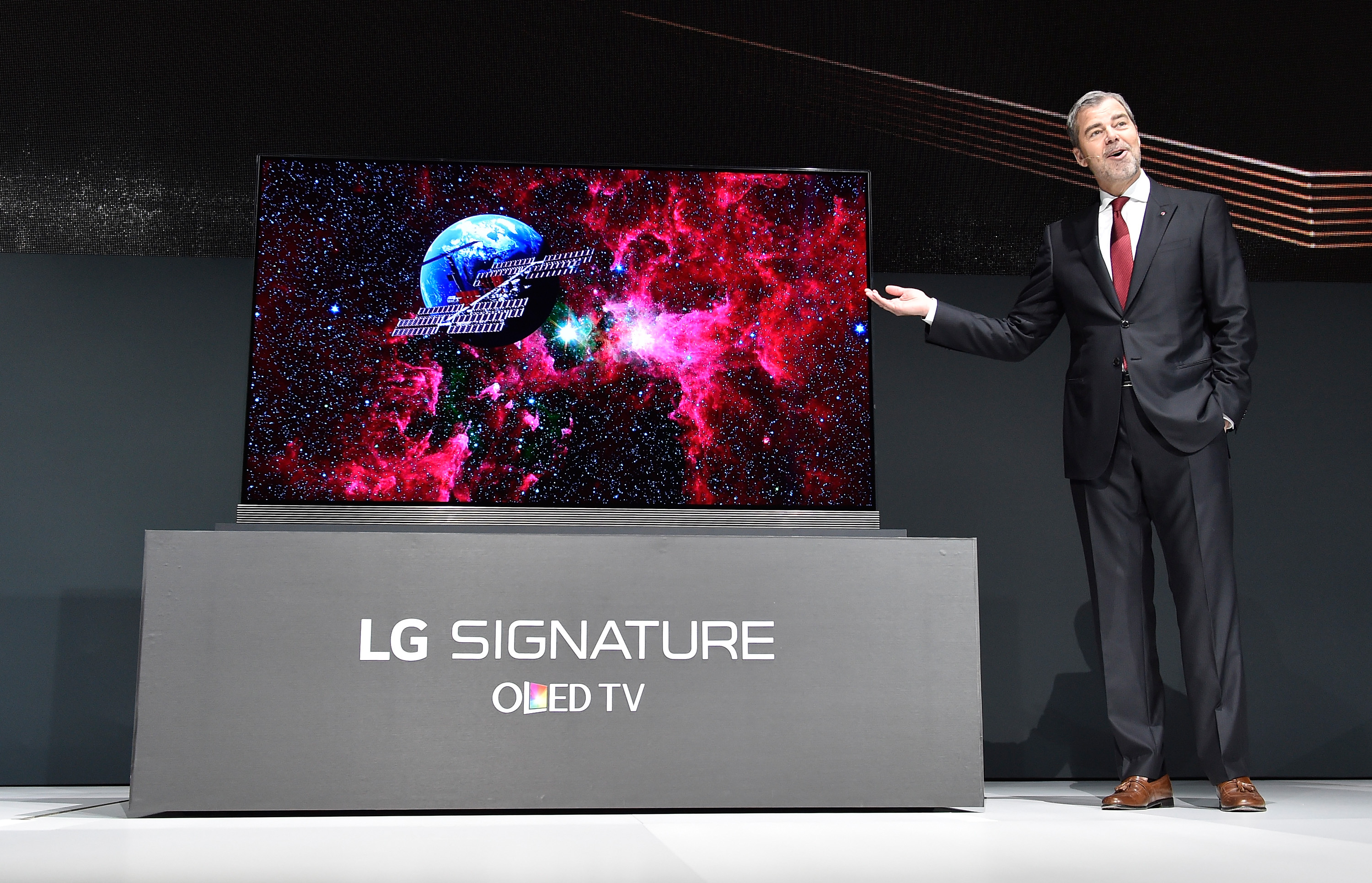 LG Electronics USA Vice President of Marketing David VanderWaal gestures as he displays the LG Signature 77 inch 4K HDR-enabled OLED TV during a press event for CES 2016 at the Mandalay Bay Convention Center on January 5, 2016 in Las Vegas, Nevada.