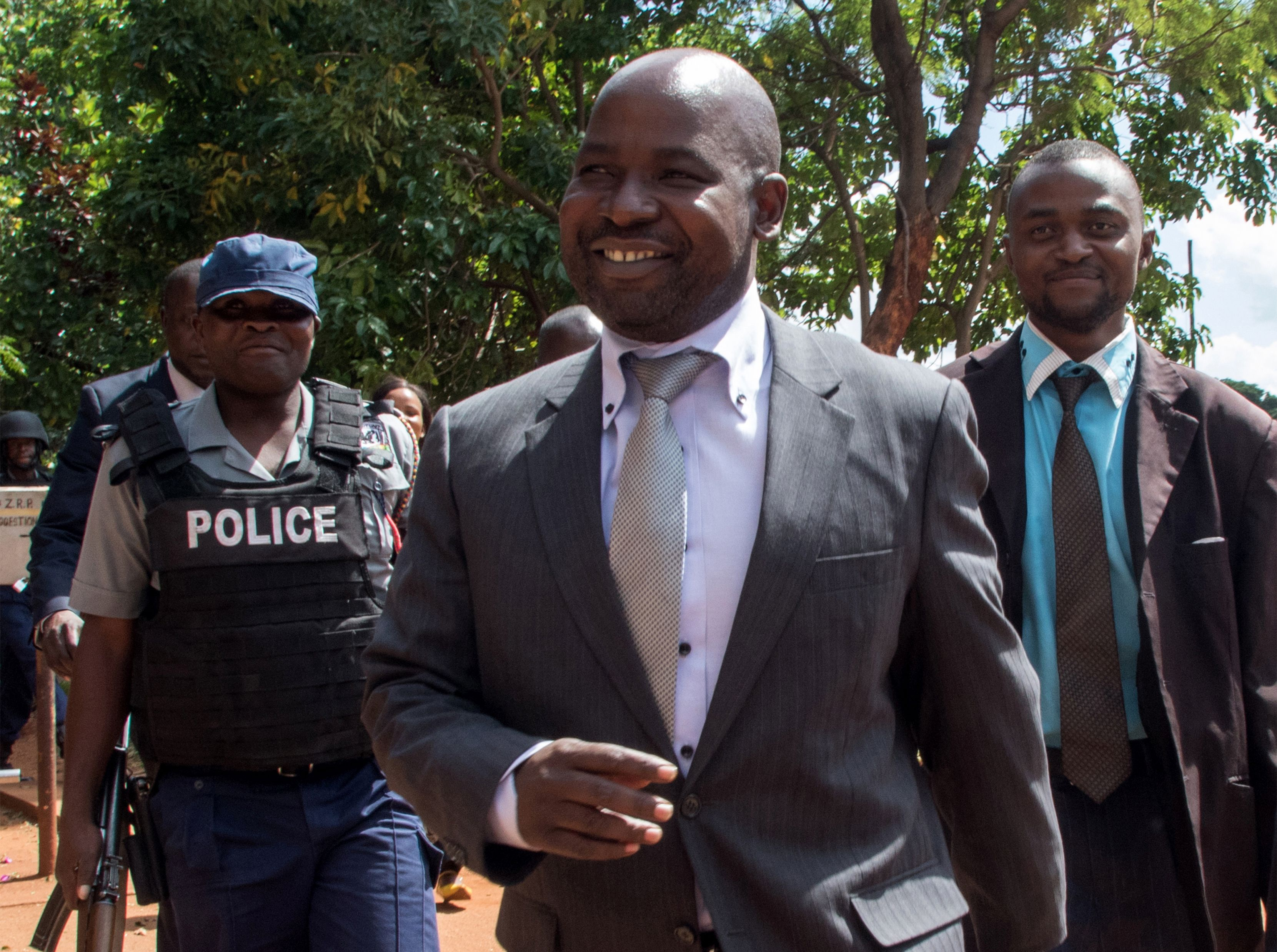 Zimbabwe's chief prosecutor Johannes Tomana (C) arrives at the Harare Magistrates court in Zimbabwe, on Feb. 2, 2016