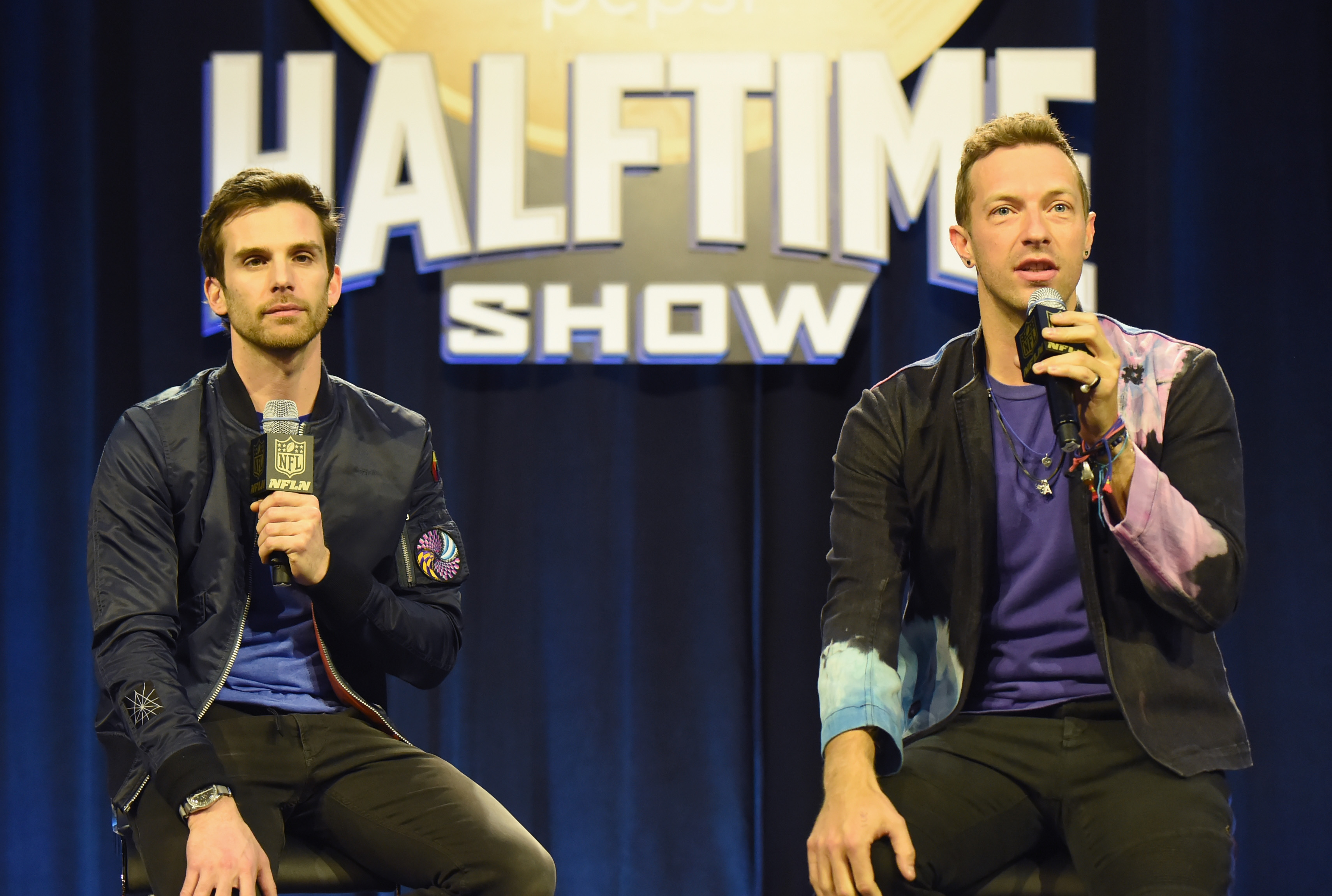 Musicians Guy Berryman and Chris Martin of Coldplay onstage at the Pepsi Super Bowl Halftime Press Conference on Feb. 4, 2016 in San Francisco