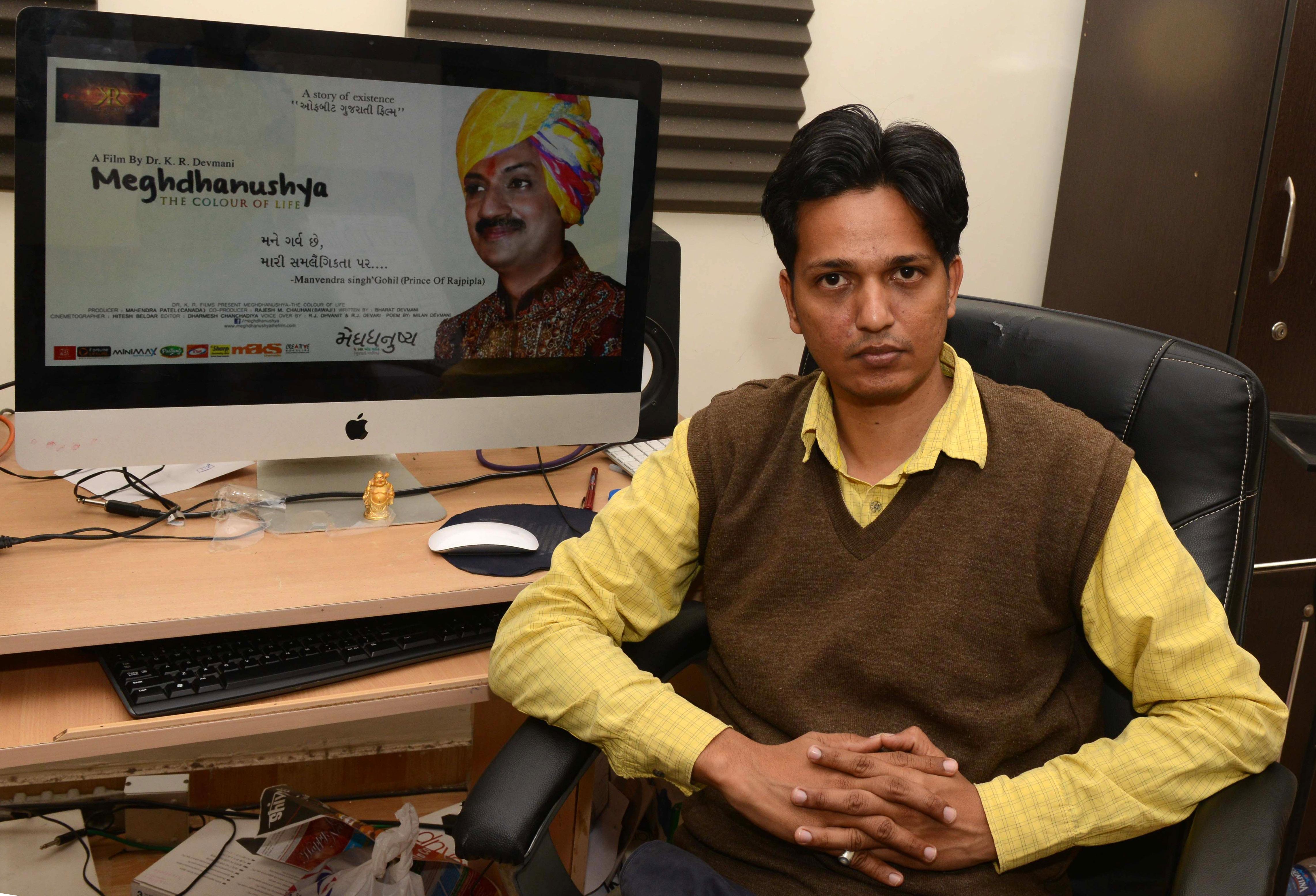 Indian filmmaker Kiran Kumar Devmani poses inside his office in Ahmedabad on Feb. 1, 2016