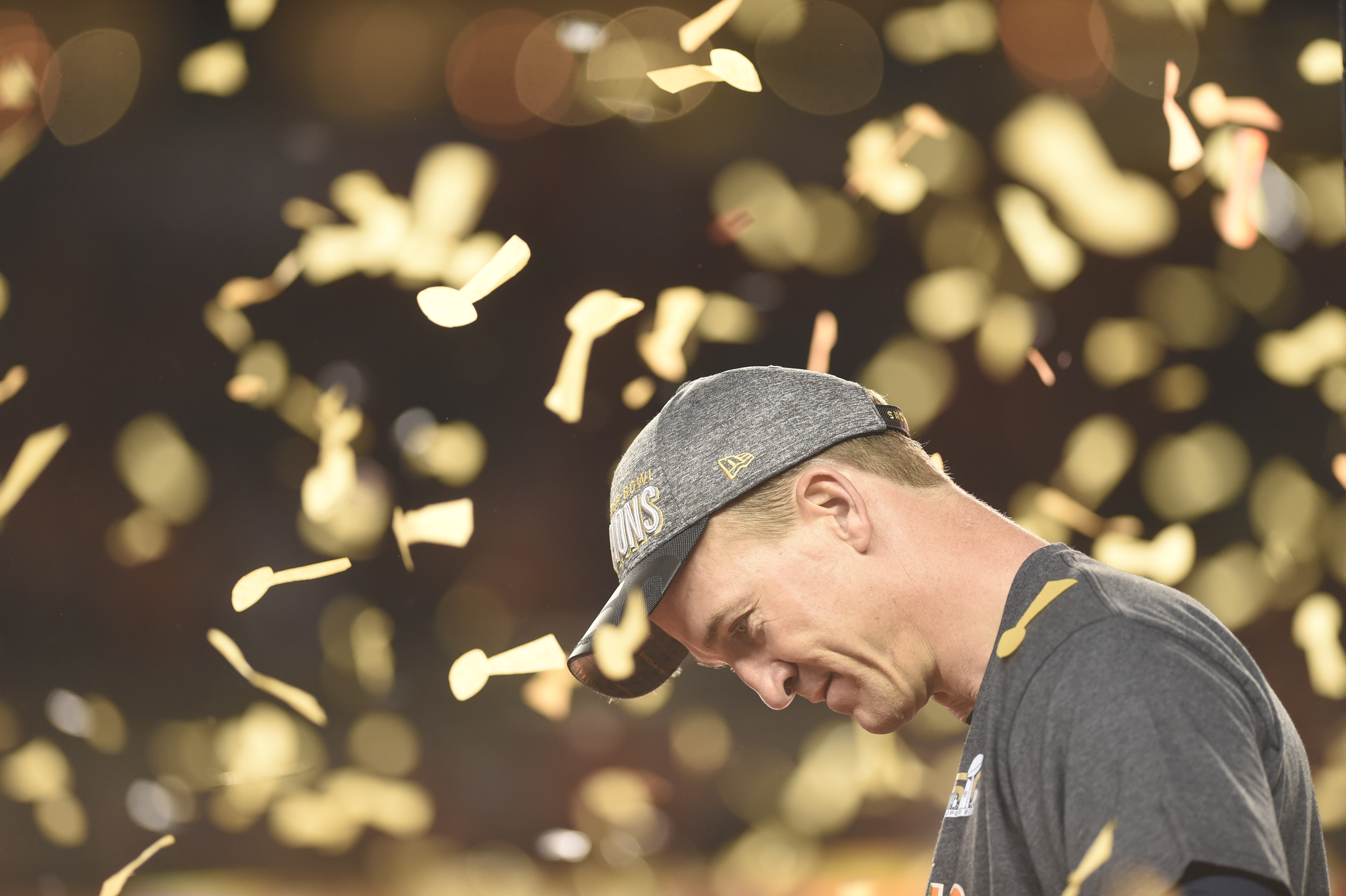 Peyton Manning of the Denver Broncos takes a moment as confetti falls after the Broncos win on Feb. 7, 2016.