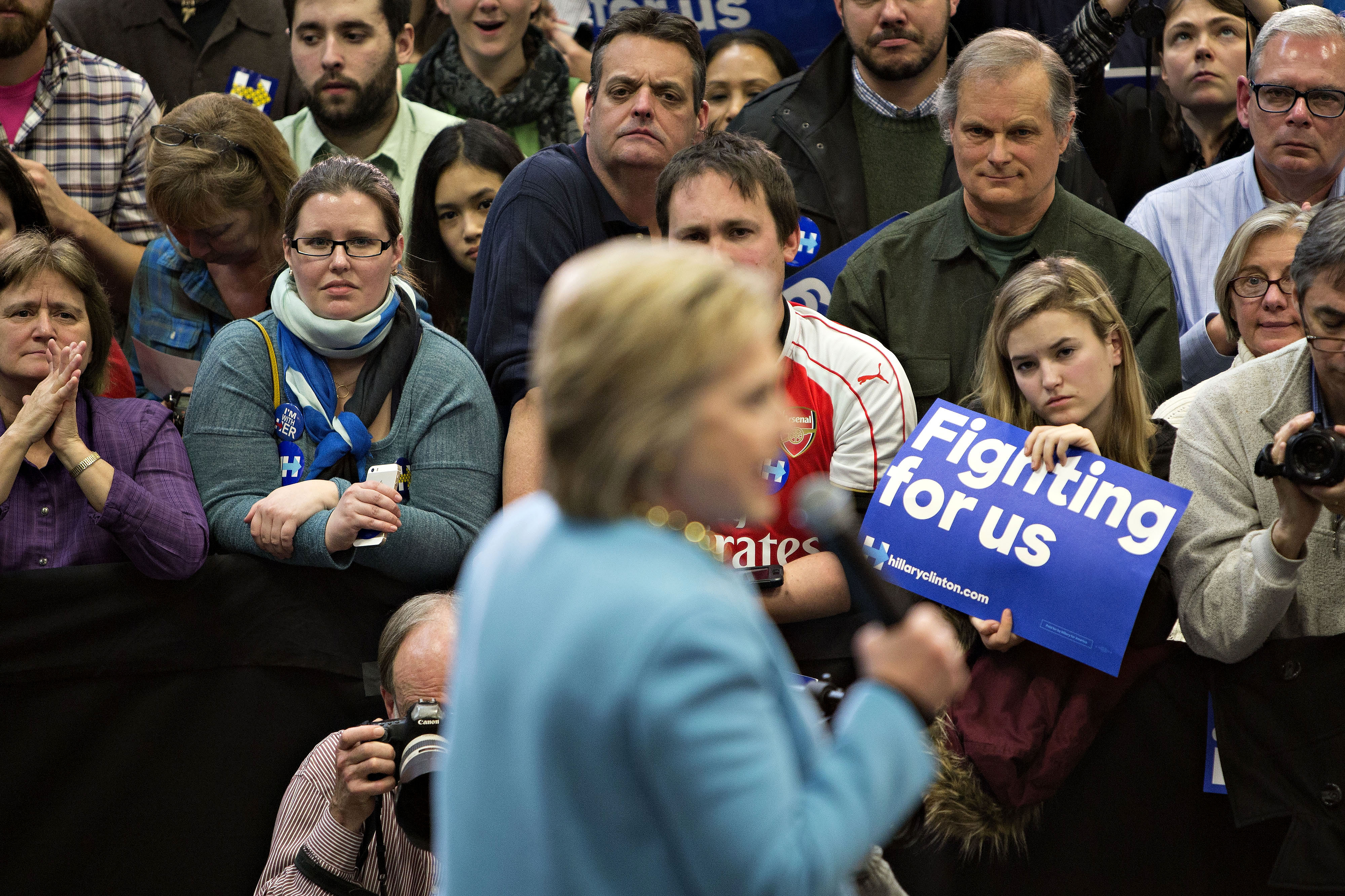 Attendees listen as Hillary Clinton, former Secretary of State and 2016 Democratic presidential candidate, speaks during a campaign event in Manchester, N.H., on Feb. 8, 2016