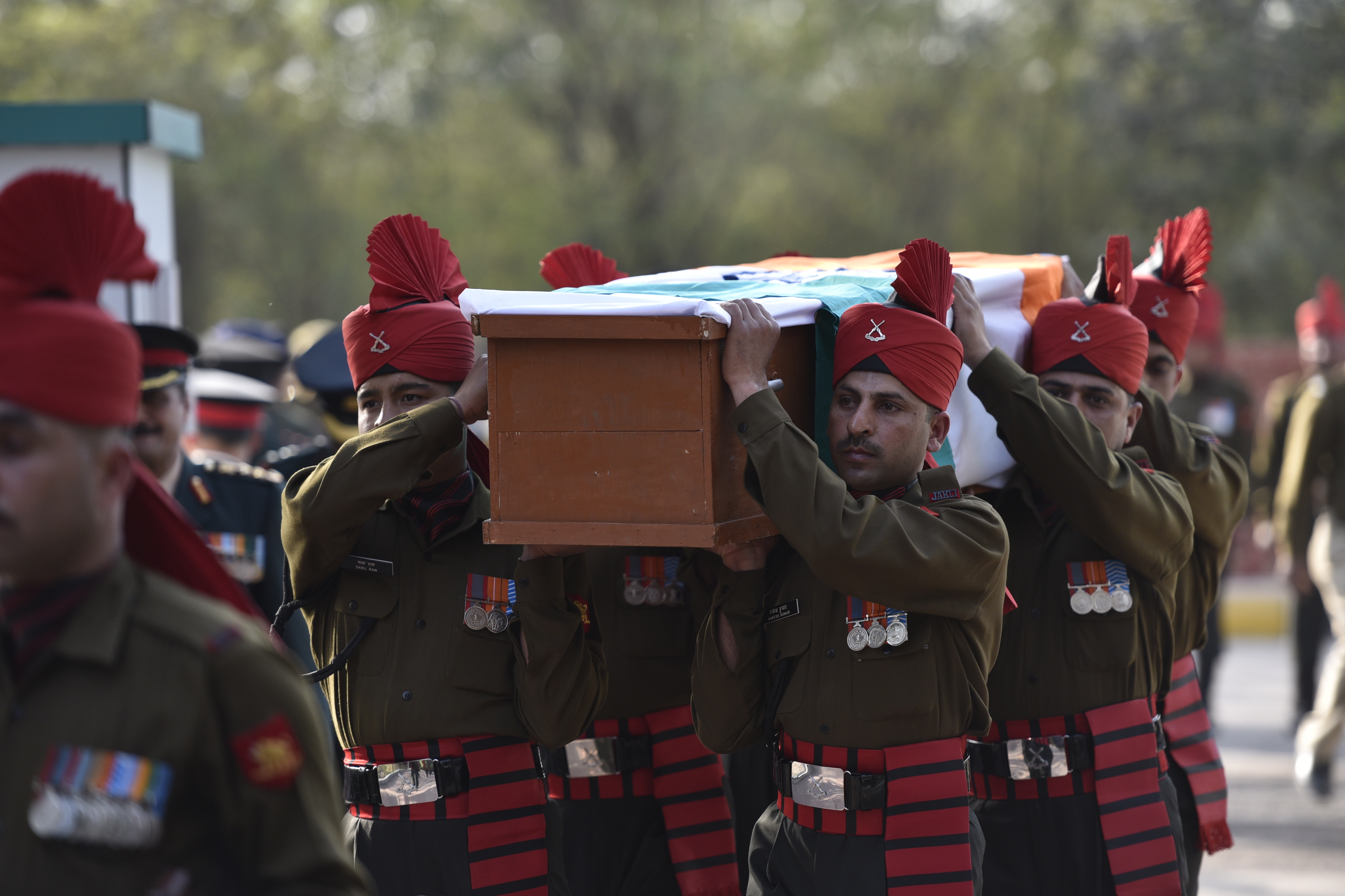 Soliders carrying the coffin of the rescued soldier Lance Naik Hanamanthappa during his funeral ceremony at Brar Square Crematorium on Feb. 11, 2016, in New Delhi