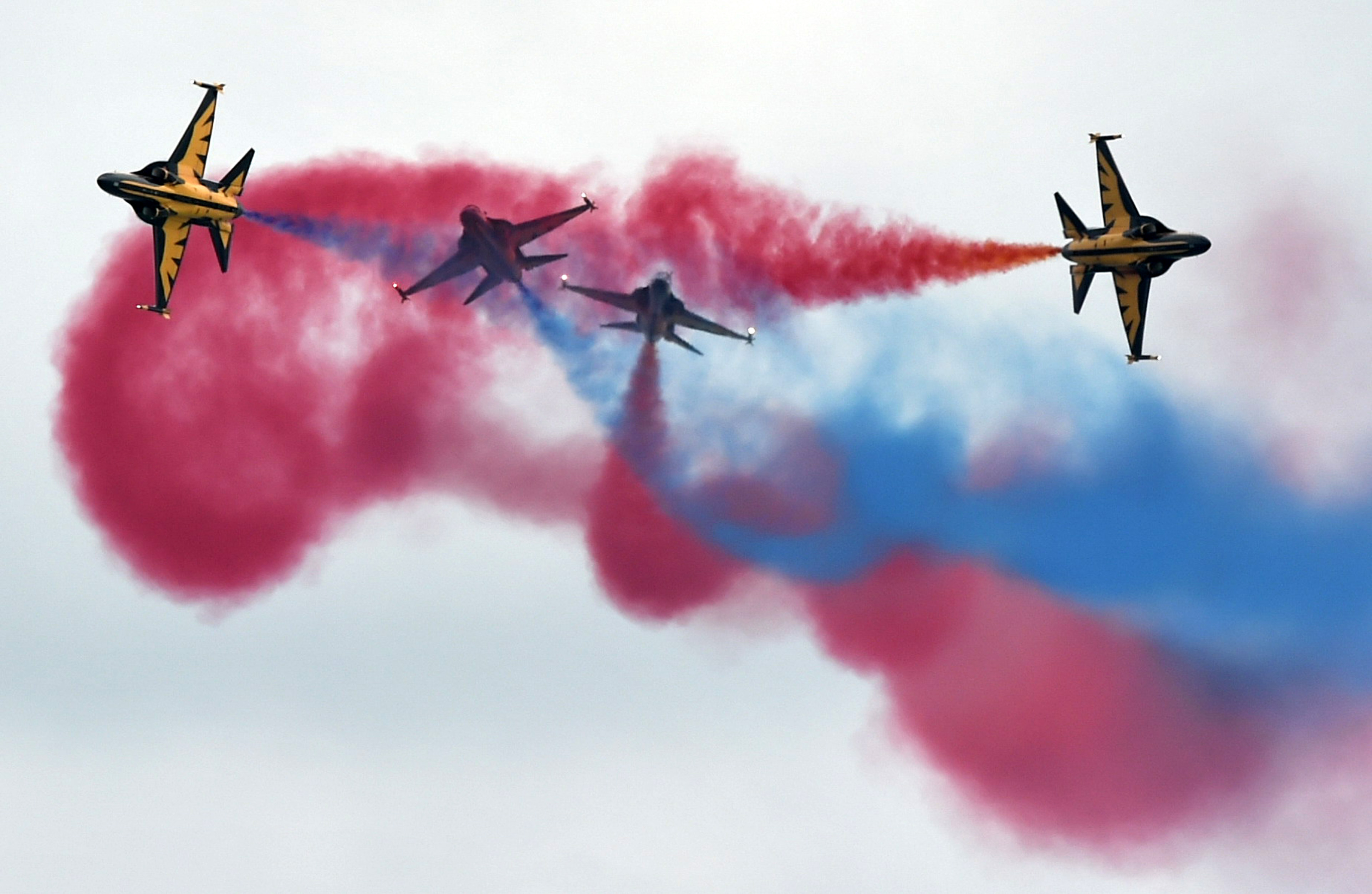 South Korea's Black Eagles aerobatics team performs an aerial display during a preview at the Singapore Airshow in Singapore on Feb.14, 2016.