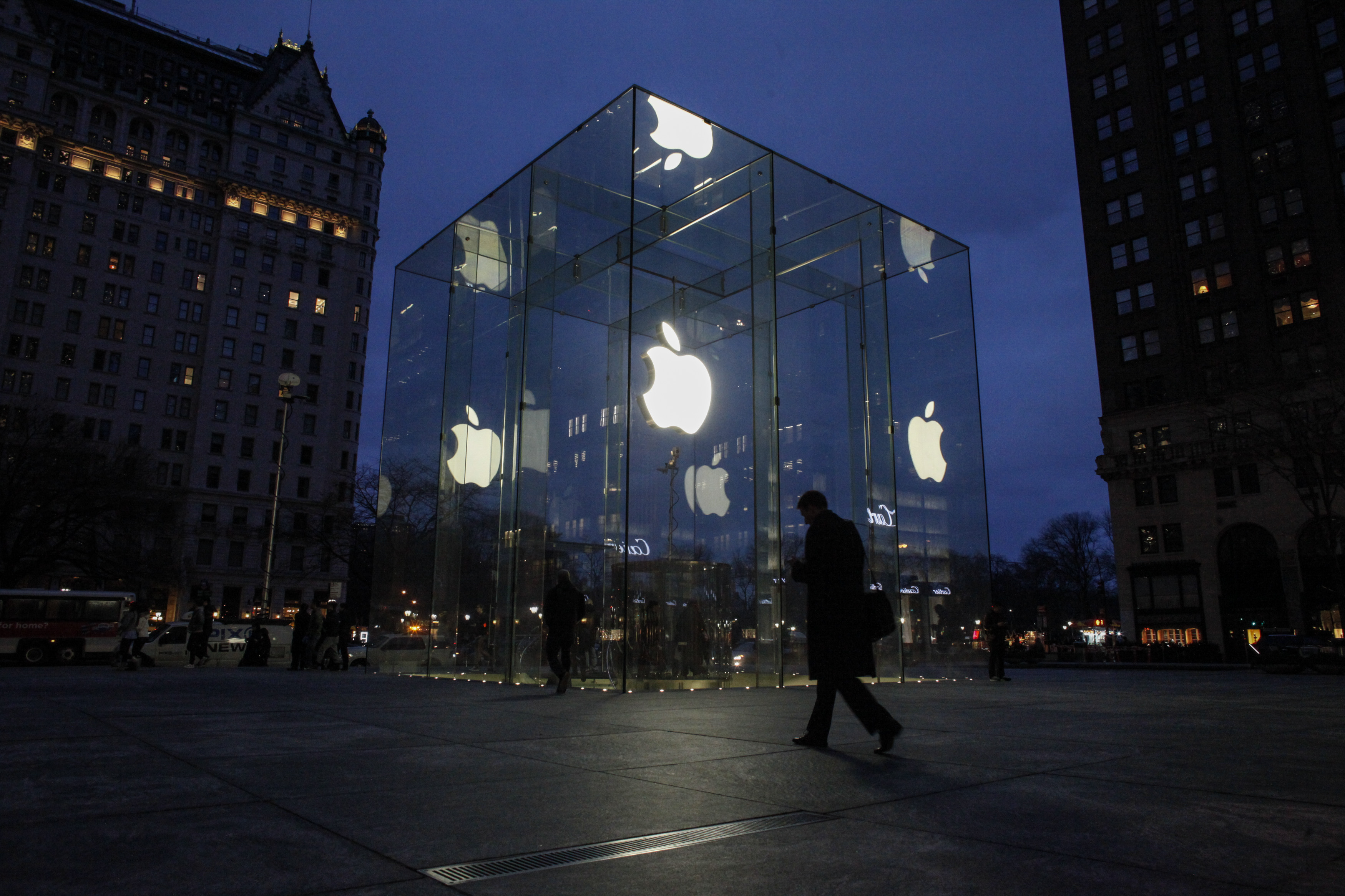 A man walks outside the Apple store on the Fifth Avenue in New York City on Feb. 17, 2016