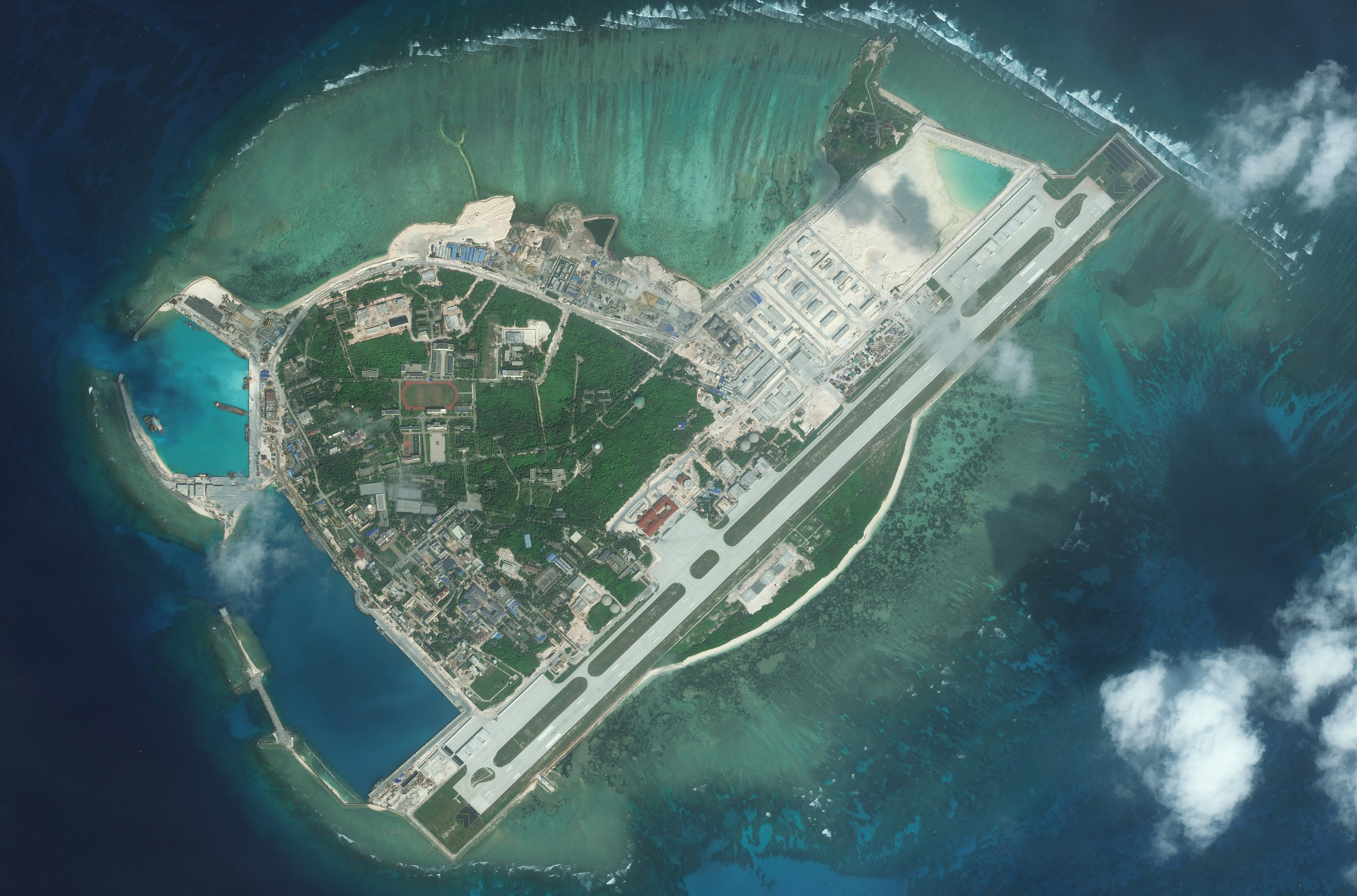 DigitalGlobe medium-view imagery from Jan. 9, 2016, of Woody Island.  Woody Island, also known as Yongxing Island and Phu Lam Island, is the largest isle of the Paracel Islands in the South China Sea