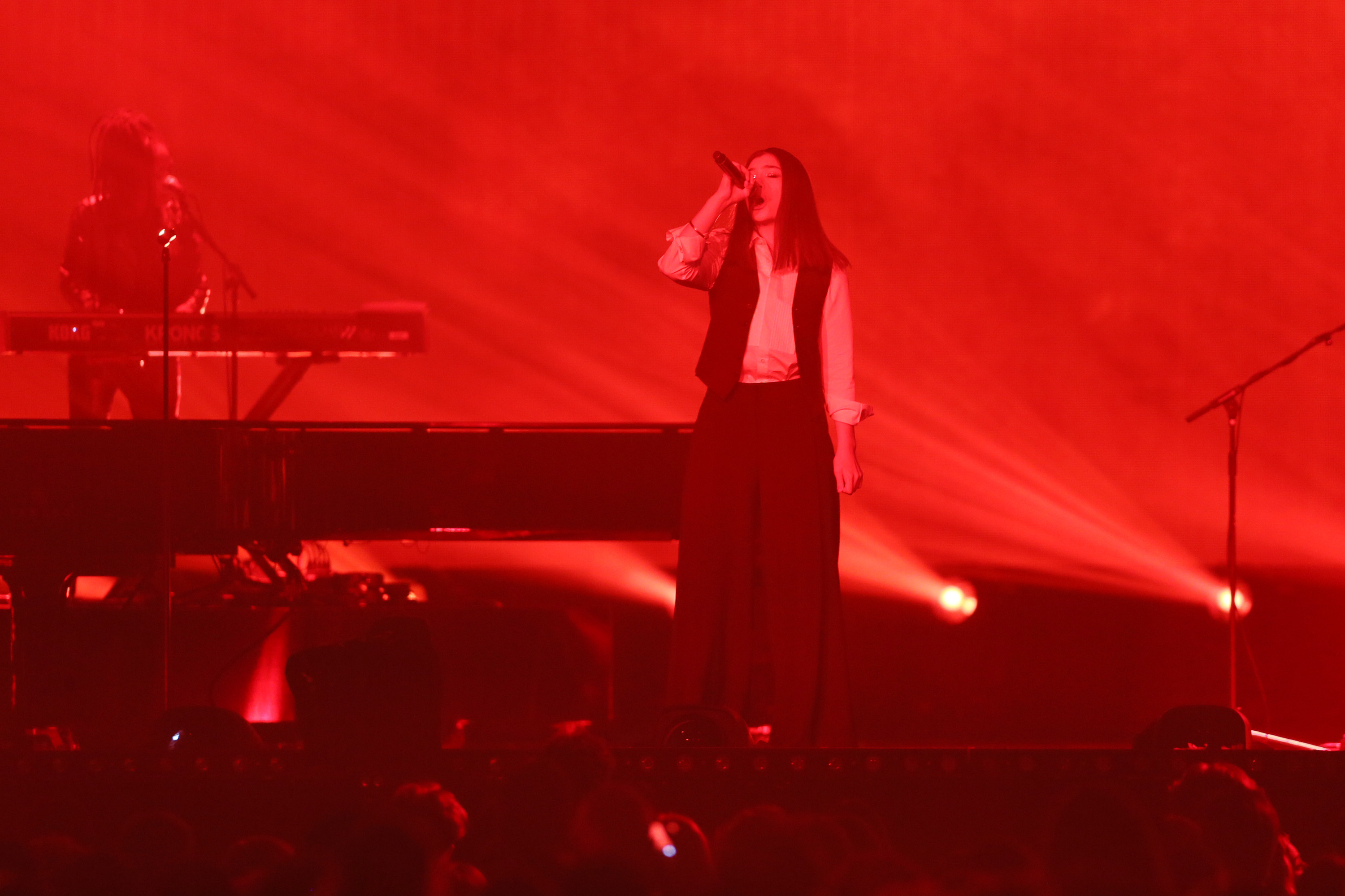 Lorde performs with David Bowie's touring band during the David Bowie tribute at the BRIT Awards 2016 at The O2 Arena on February 24, 2016, in London, England.