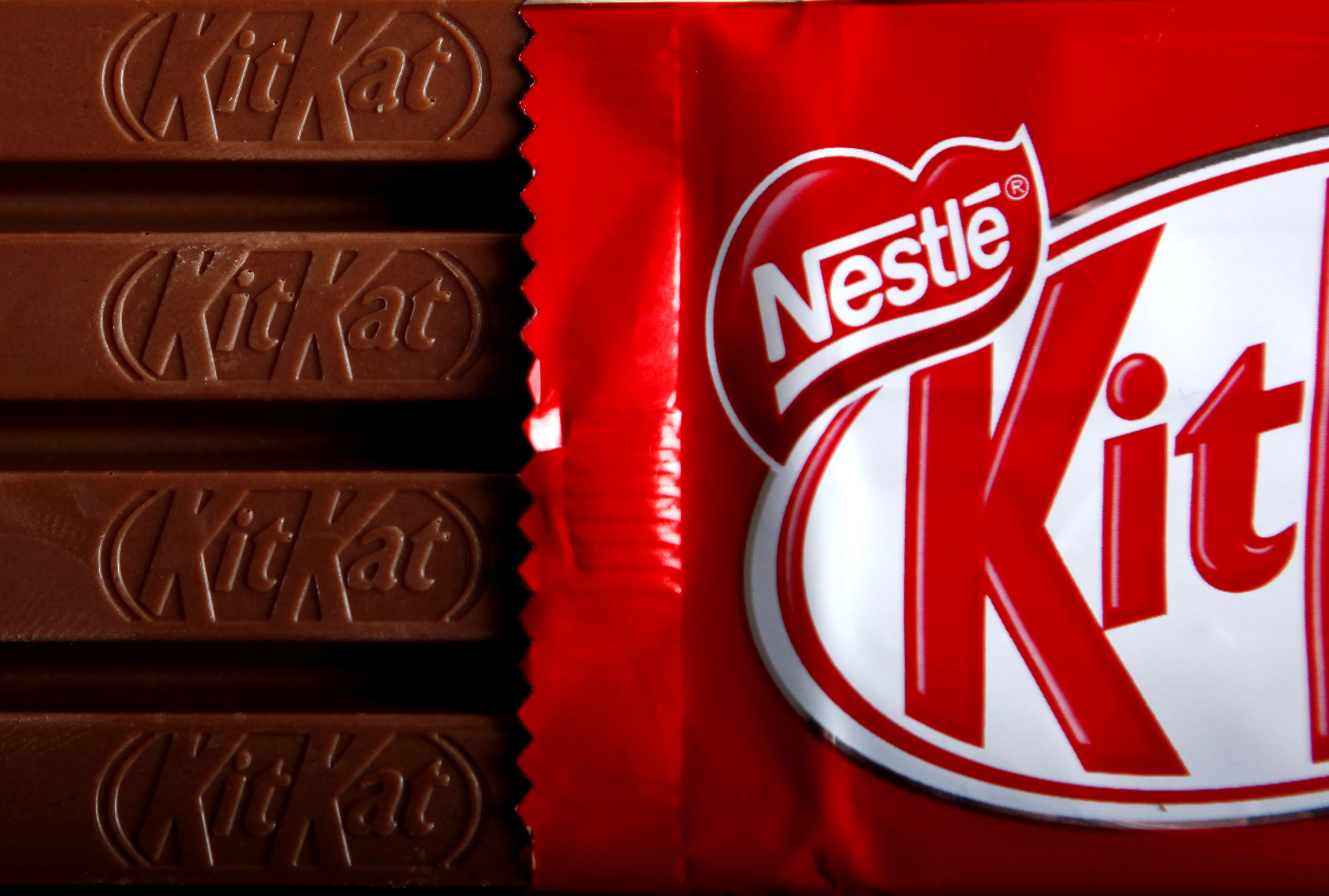 Bars of original KitKat chocolate, produced by Nestle SA, and without the  Fairtrade  logo sit arranged for a photograph in London, U.K., on Monday, Dec.7, 2009. Nestle SA, the world's biggest food company, will start certifying some KitKat bars in the U.K. and Ireland as Fairtrade, following Cadbury Plc, which started producing mass-market Fairtrade chocolate this year.