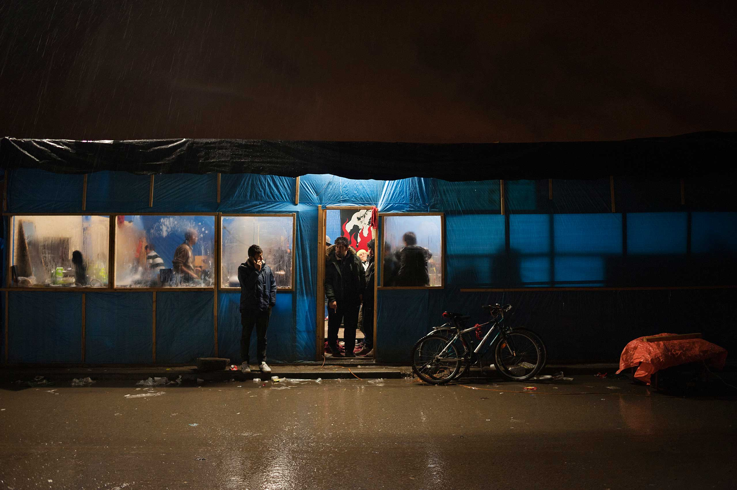 Shelter from the rain in an Afghan restaurant in Calais, France on Nov. 4, 2015.
