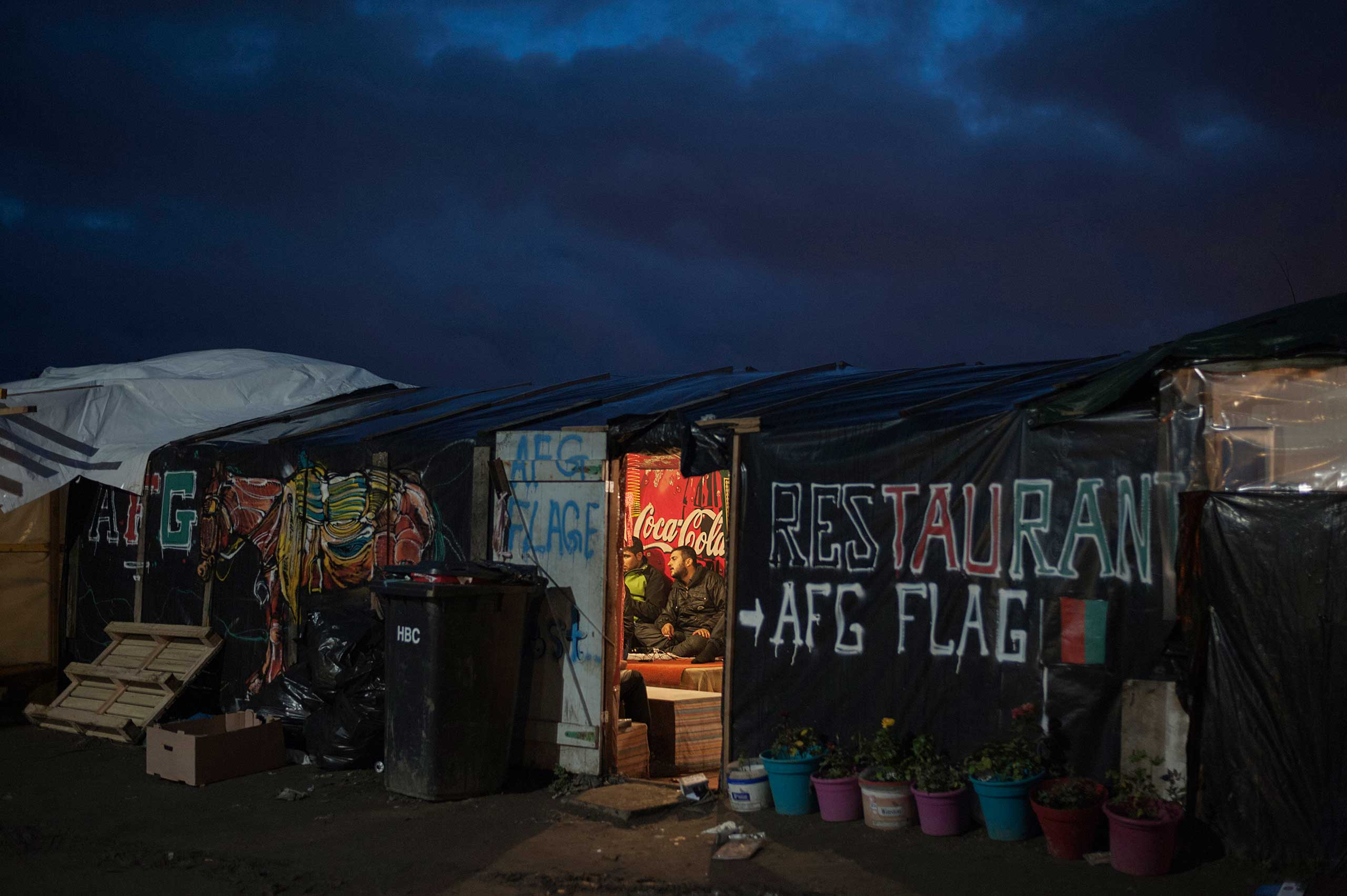 People chatting in an Afghan bar and restaurant in Calais, France on Nov. 7, 2015.