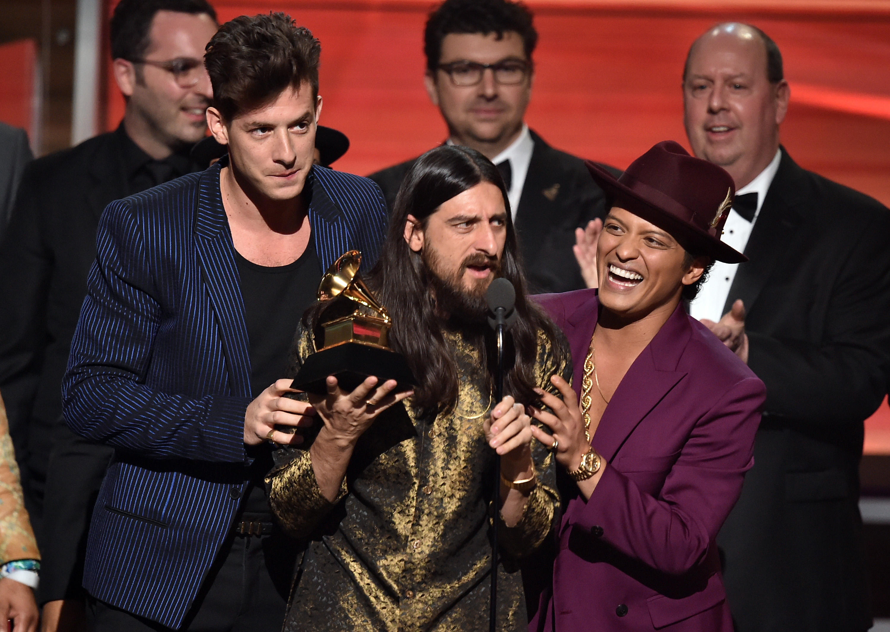 From left: Mark Ronson, Jeff Bhasker, and Bruno Mars accept  Record Of The Year  during the 58th GRAMMY Awards at Staples Center on Feb. 15, 2016 in Los Angeles.