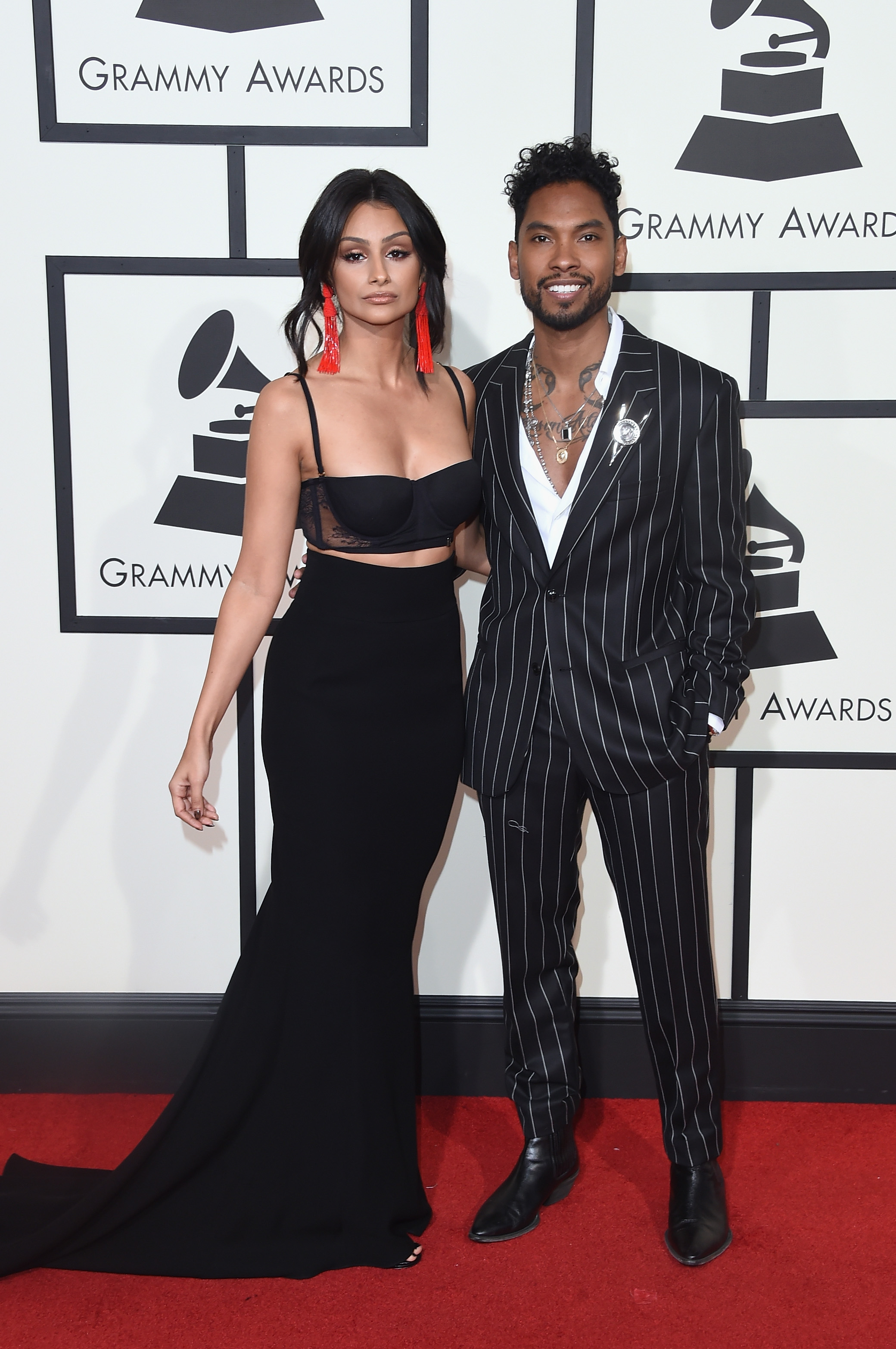 Nazanin Mandi, left, and Miguel, right, attend the 58th GRAMMY Awards at Staples Center on Feb. 15, 2016 in Los Angeles.