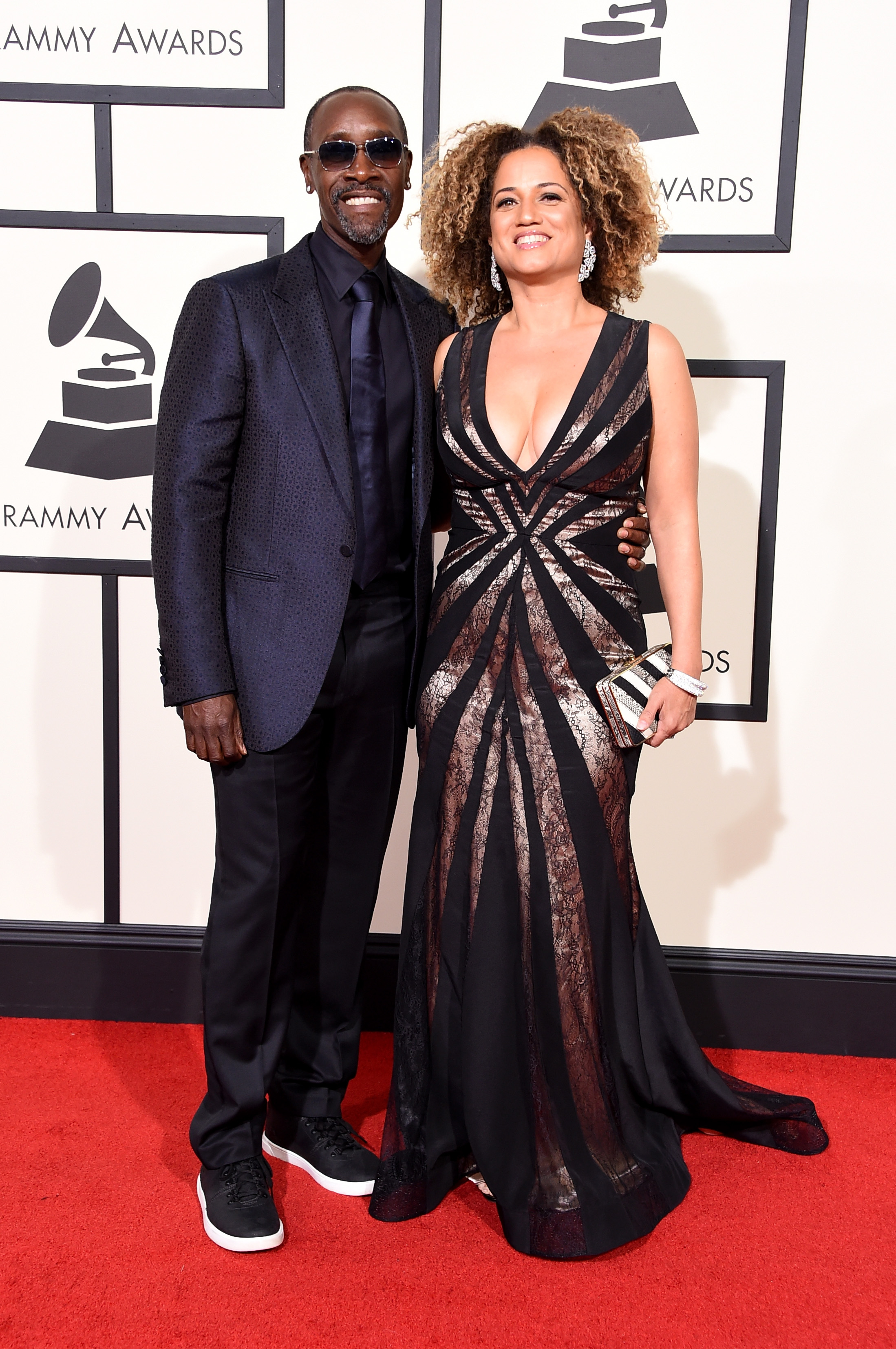 Don Cheadle, left, and Bridgid Coulter, right, attend the 58th GRAMMY Awards at Staples Center on Feb. 15, 2016 in Los Angeles.