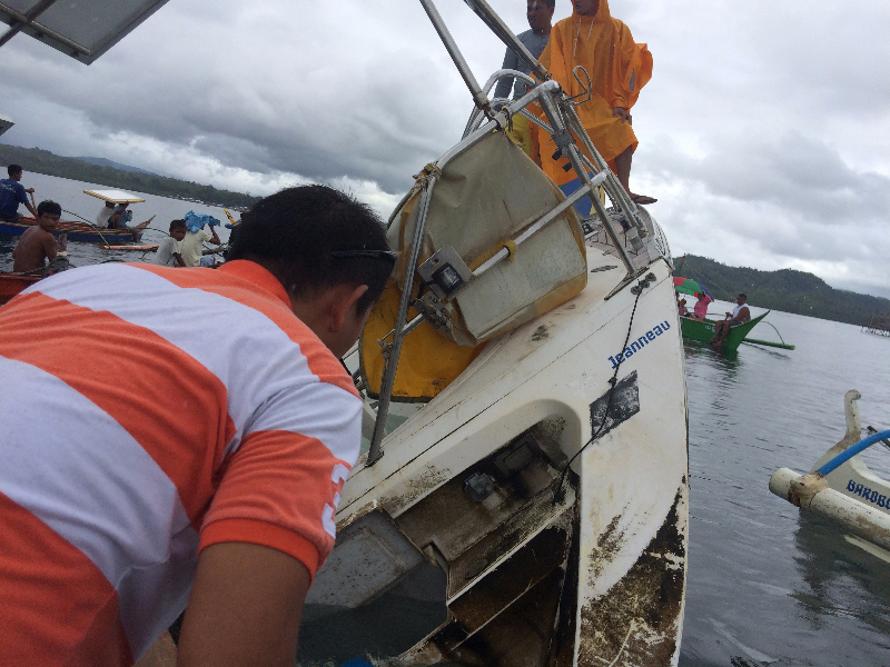 Filipino fishermen recovering a drifting yacht in the seas off the Philippine town of Barobo, in Surigao del Sur province, on Feb. 27, 2016
