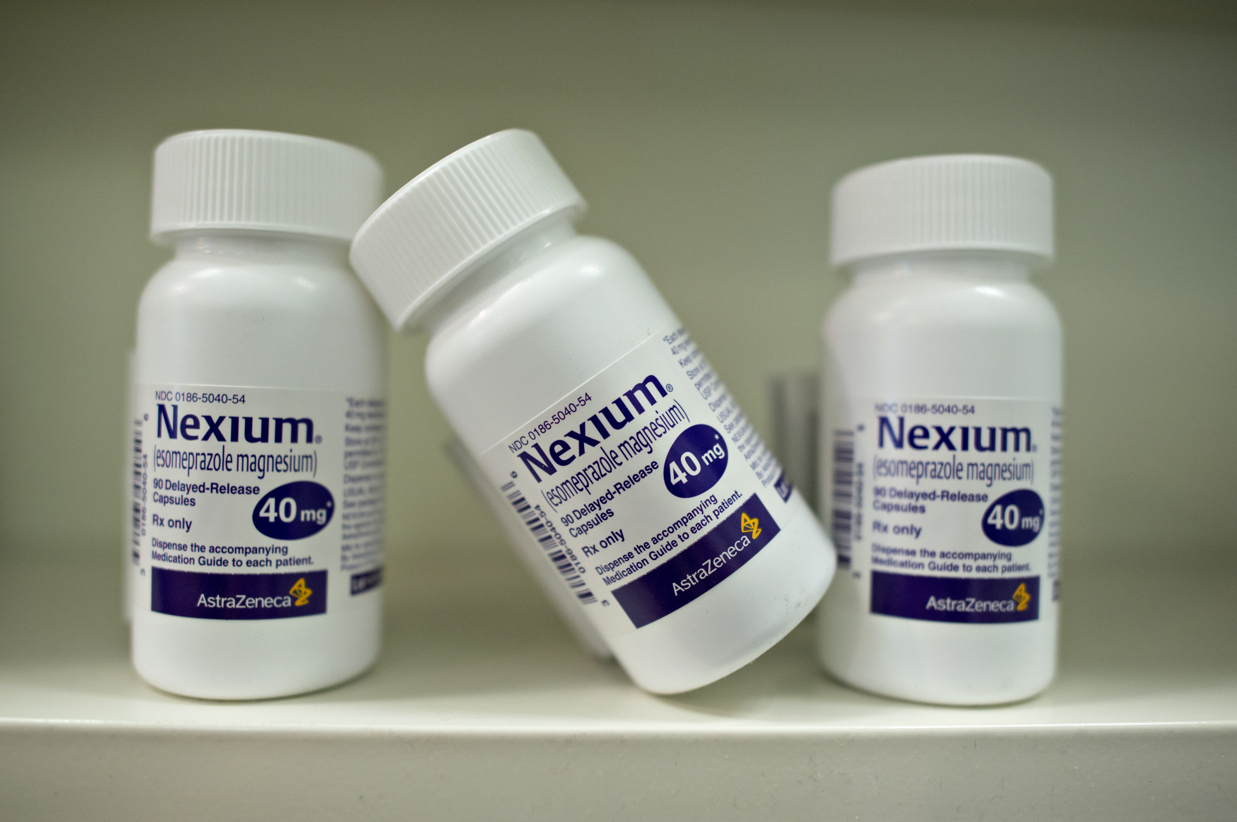 Bottles of AstraZeneca Plc's Nexium heartburn medication are arranged for a photograph at a pharmacy in Princeton, Illinois, U.S., on Wednesday, Aug. 20, 2014.