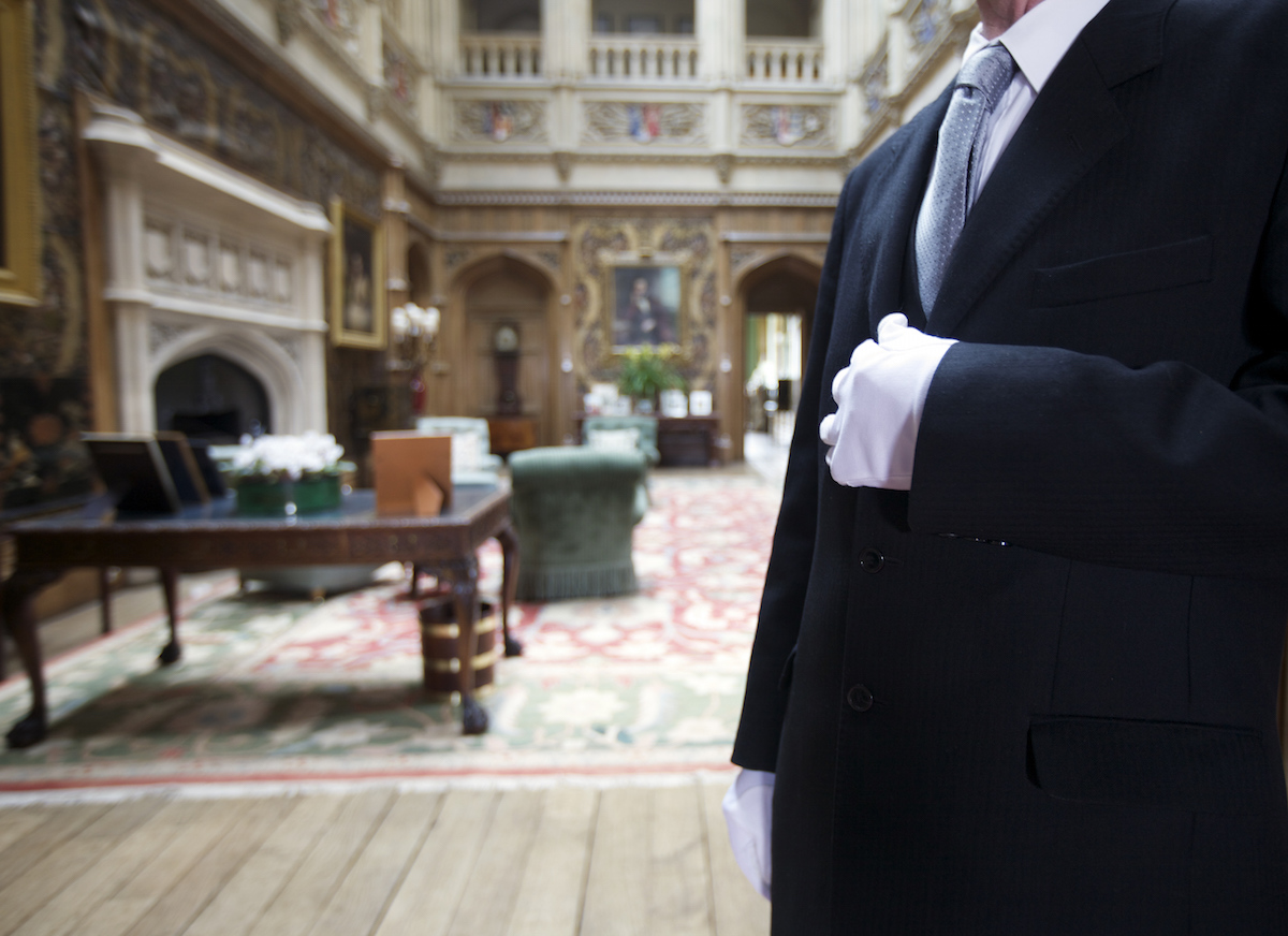 The butler poses in the saloon at Highclere Castle on March 15, 2011 in Newbury, England.