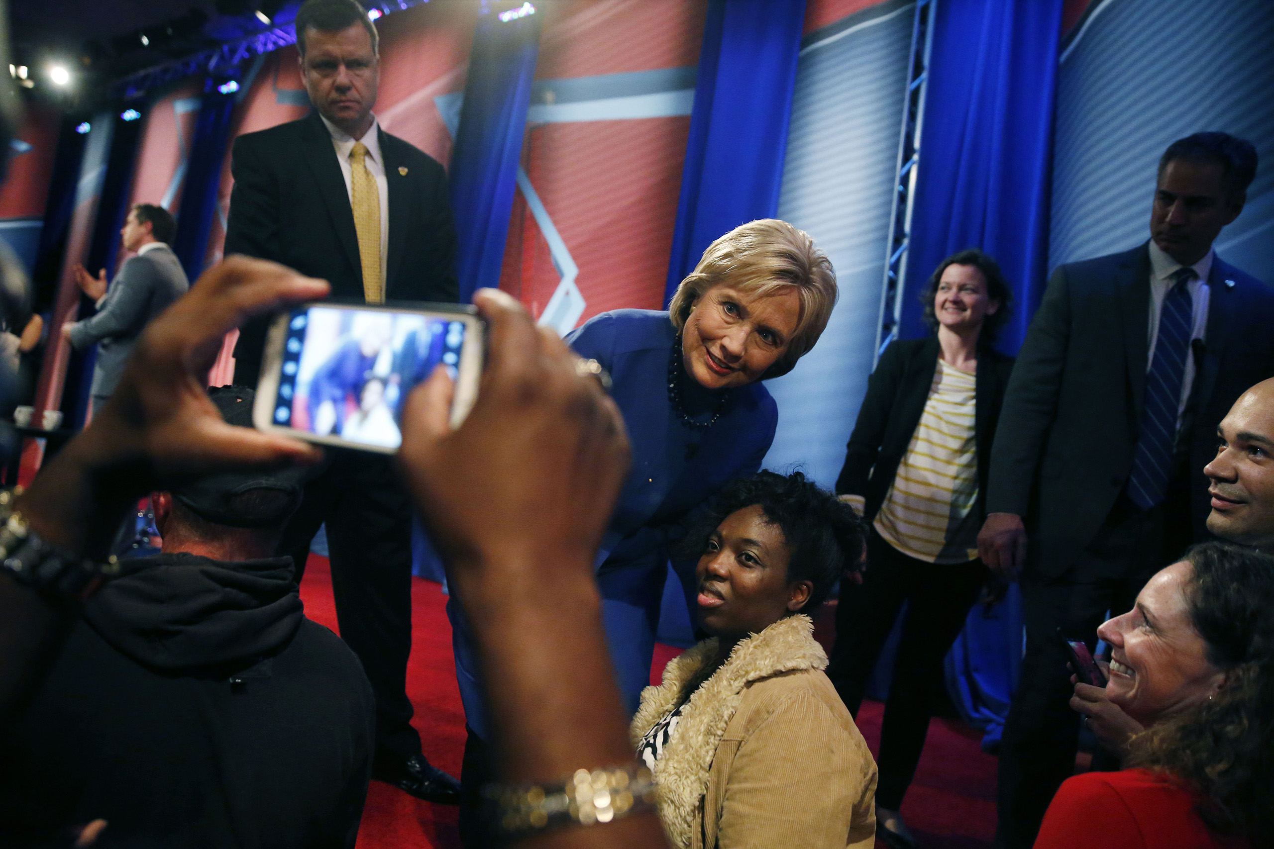 Democratic presidential candidate Hillary Clinton poses for photos with audience members after participating in a CNN town hall event at the University of South Carolina School of Law in Columbia, Feb. 23, 2016.