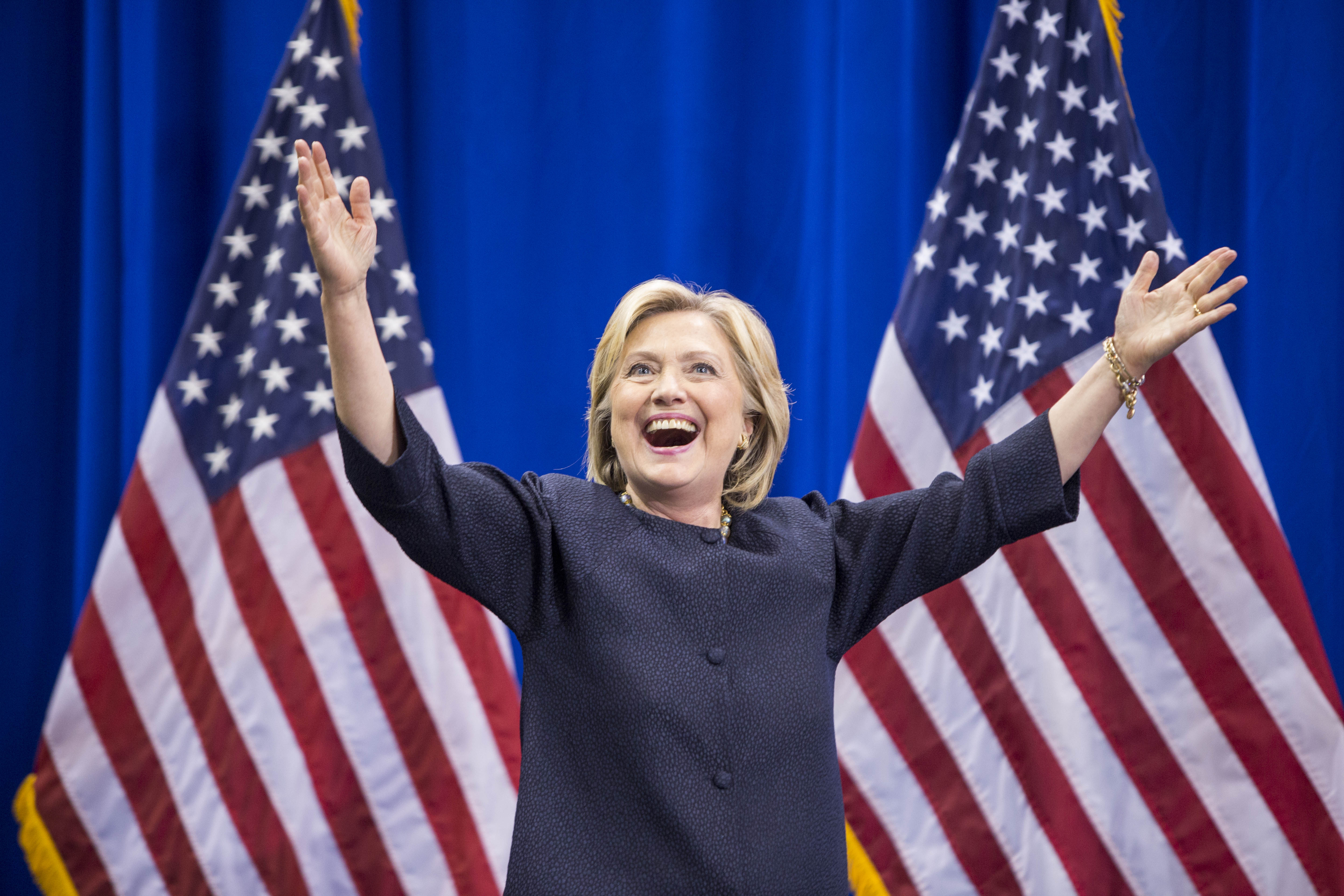 Democratic presidential candidate Hillary Clinton raises her arms stands on stage during the New Hampshire Democratic Party Convention at the Verizon Wireless Center on Sept. 19, 2015 in Manchester, New Hampshire.