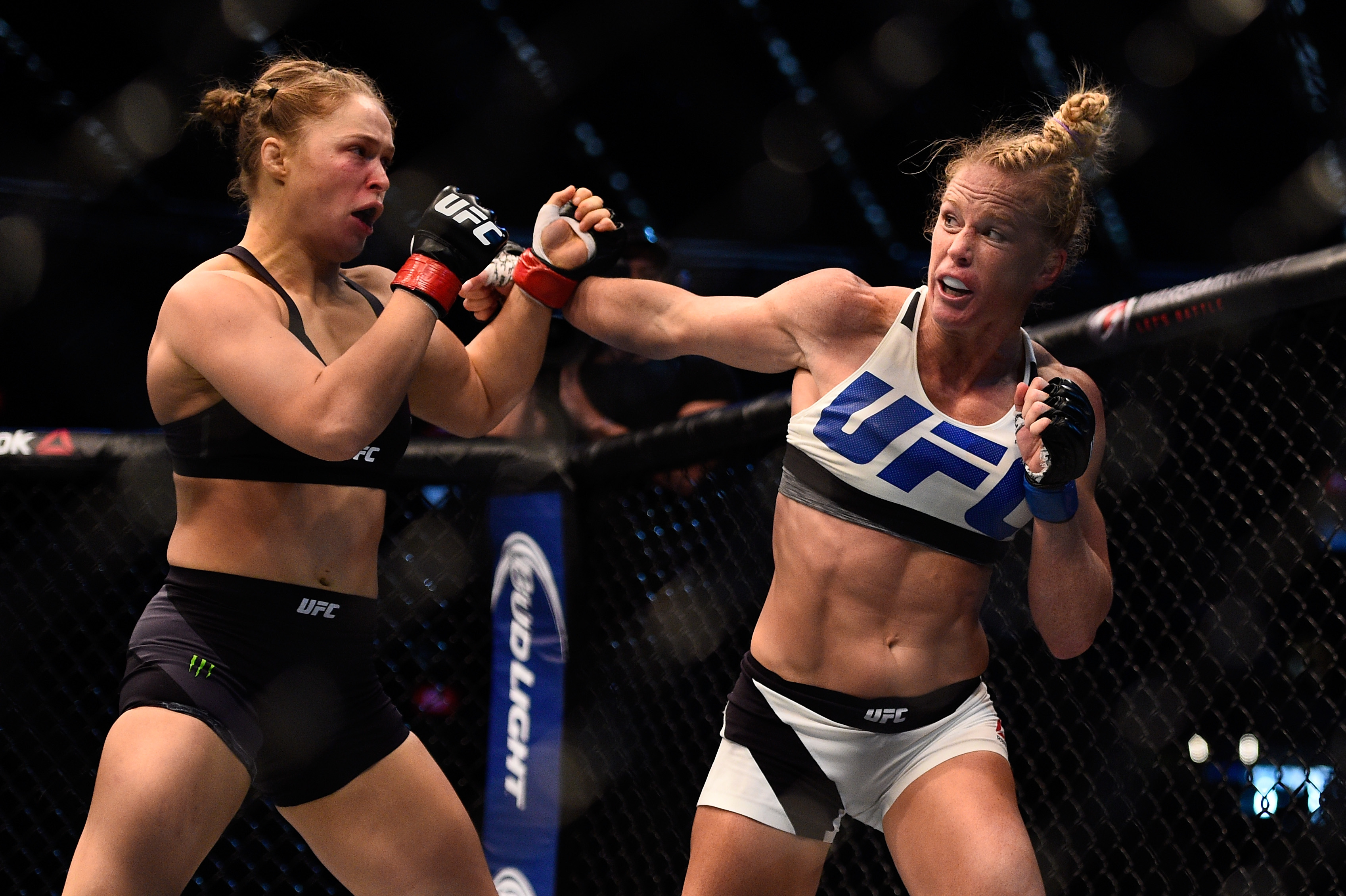 Ronda Rousey blocks a punch from Holly Holm in their UFC women's bantamweight championship bout during the UFC 193 event at Etihad Stadium on November 15, 2015 in Melbourne, Australia.
