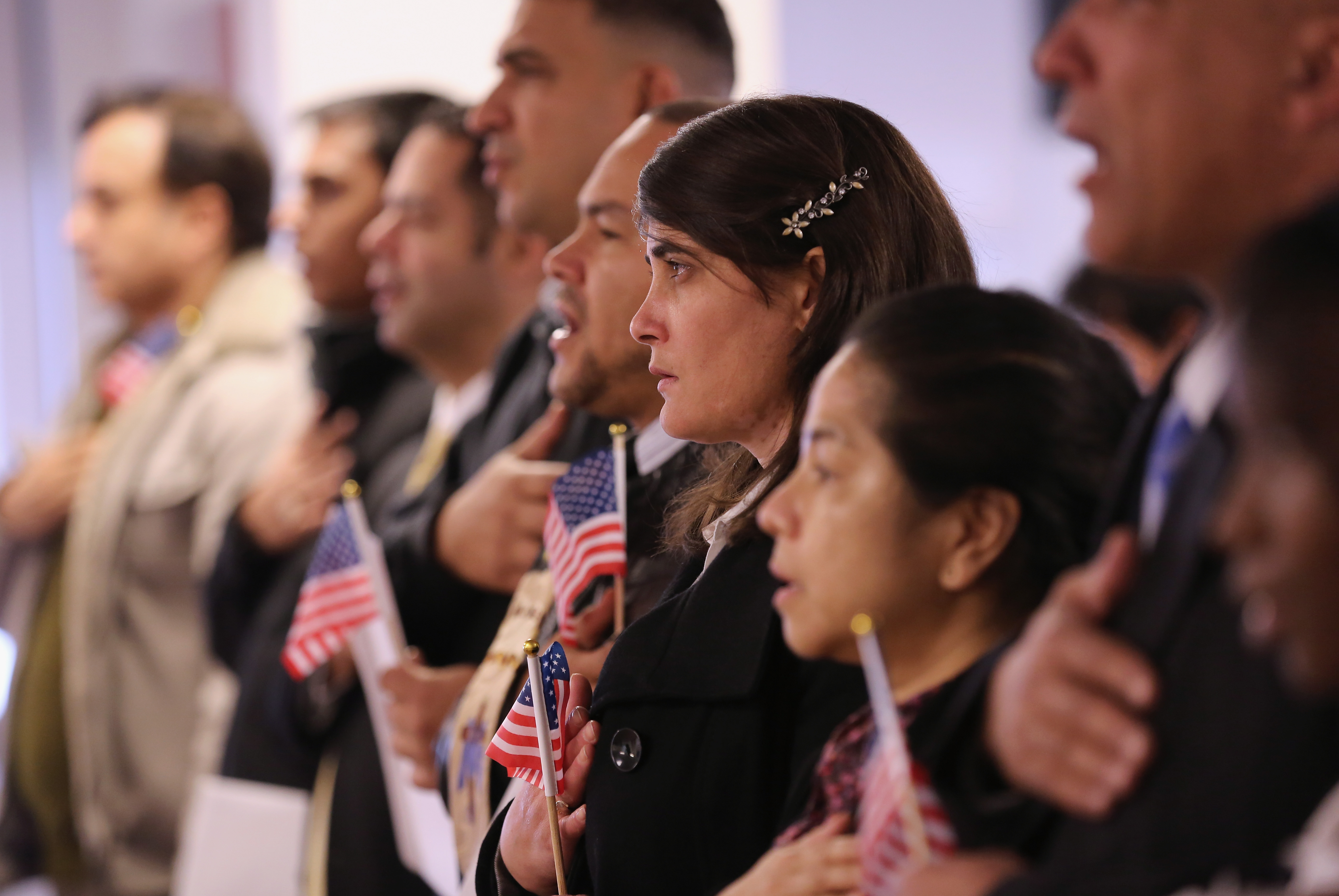 Immigrants take oath of citizenship to the United States on Nov. 20, 2014 in Newark, New Jersey.