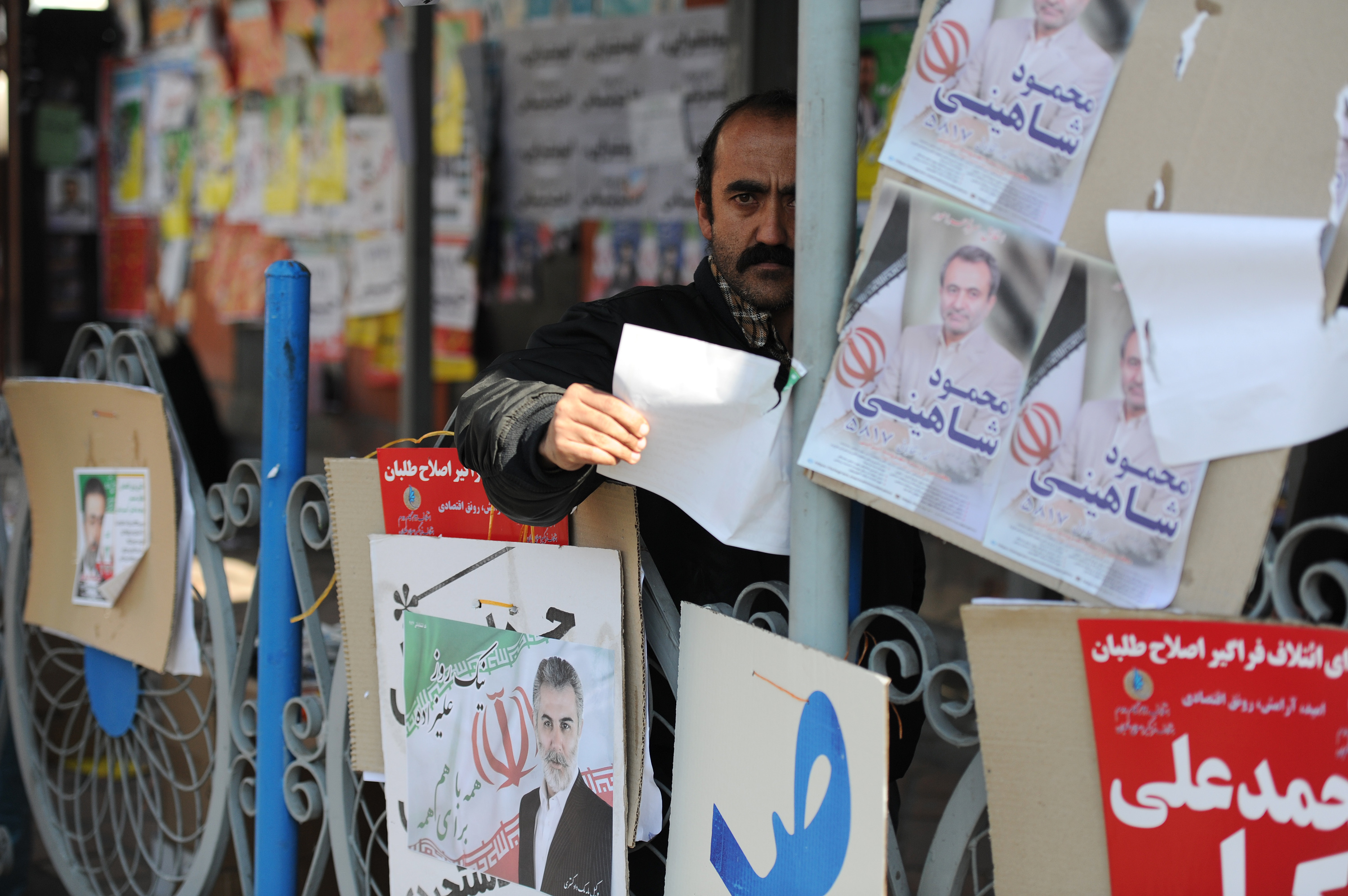 Streets are plastered with posters on the eve of elections for Parliament and the Assembly of Experts in Tehran, on Feb. 25, 2016.