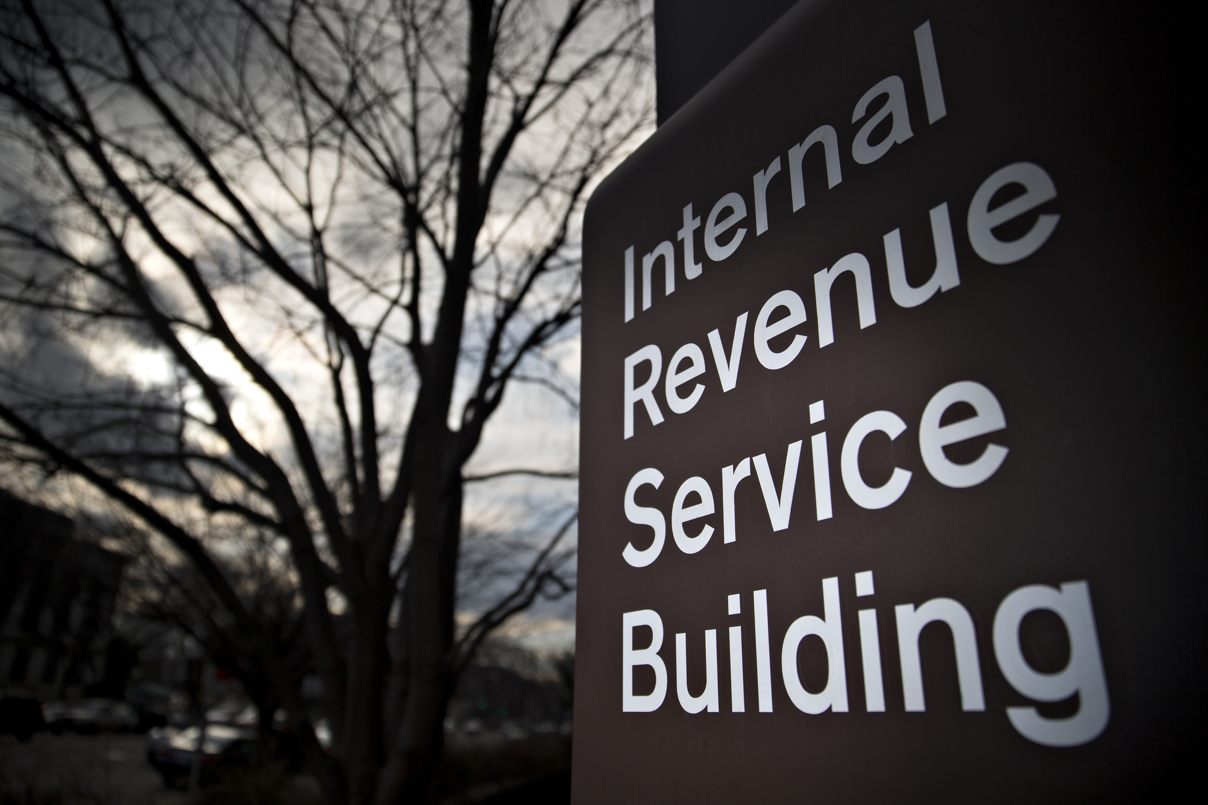 Signage for the Internal Revenue Service (IRS) stands outside the IRS headquarters building in Washington, D.C., U.S., on Wednesday, Feb. 17, 2016.