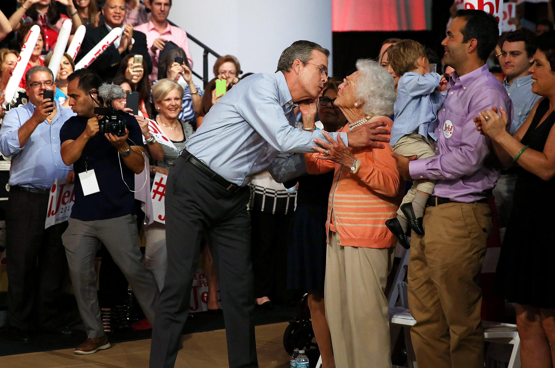 Former Florida Gov. Jeb Bush kisses his mother Barbara Bush on June 15 , 2015 in Miami.