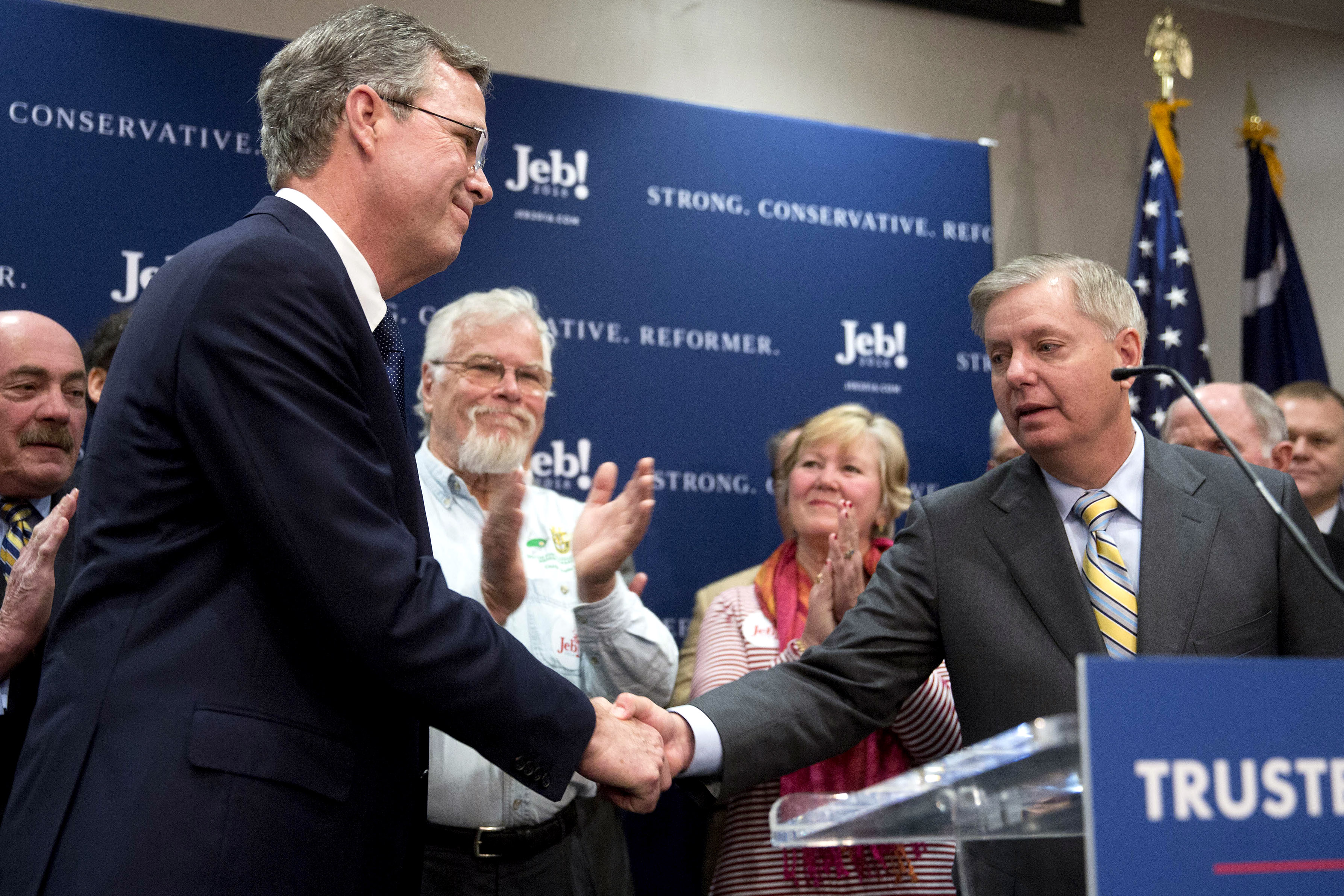 Former Florida Gov. Jeb Bush shakes hands with South Carolina Senator Lindsey Graham during a news conference in which Graham endorsed Bush for president in North Charleston, S.C. on Jan. 15, 2016.