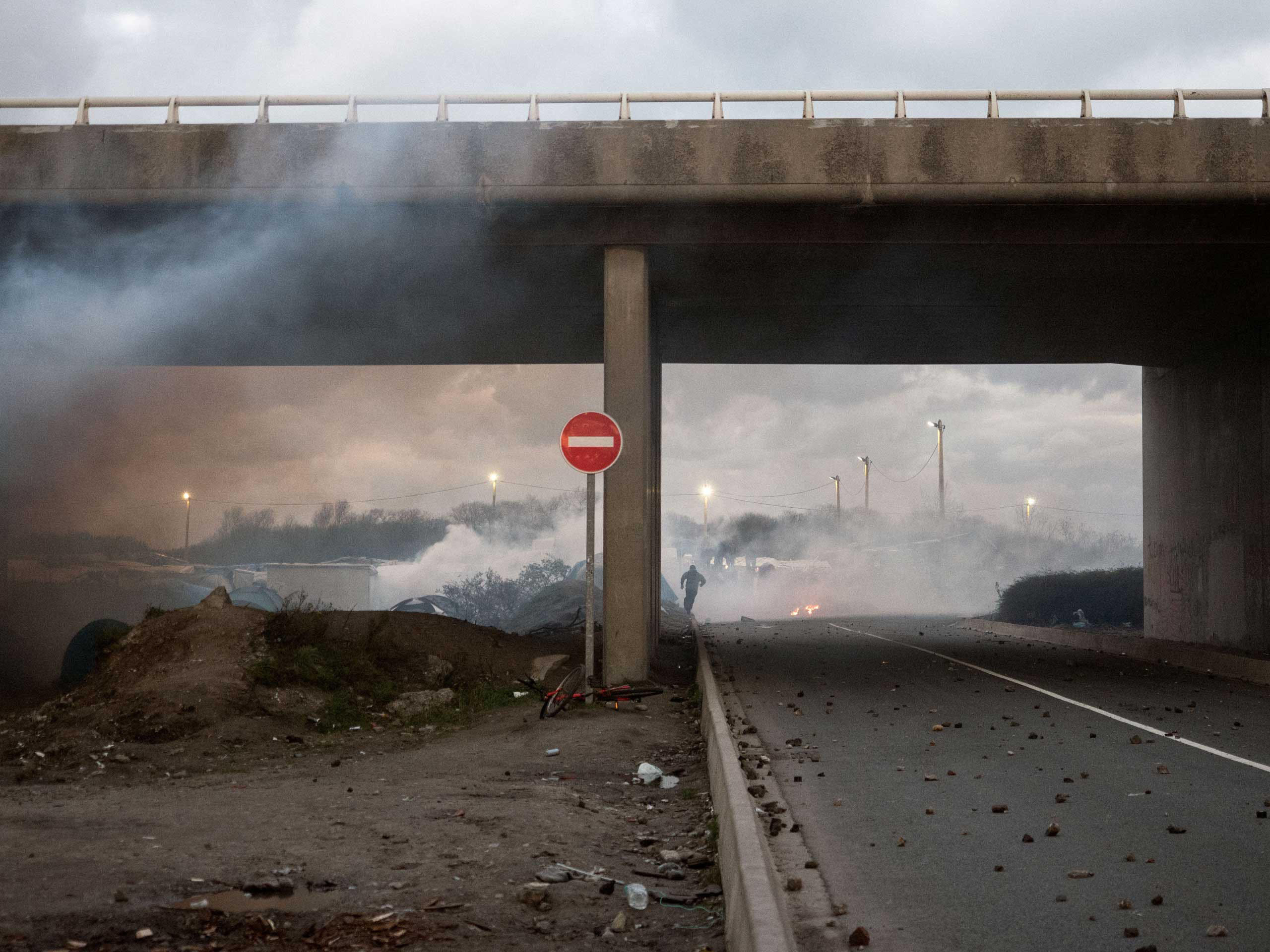 A clash between migrants and police in Calais, France, Nov. 25, 2015, where a mix of refugees, asylum seekers and economic migrants from Darfur, Afghanistan, Syria, Iraq, and Eritrea live in the shantytown known as the  jungle.