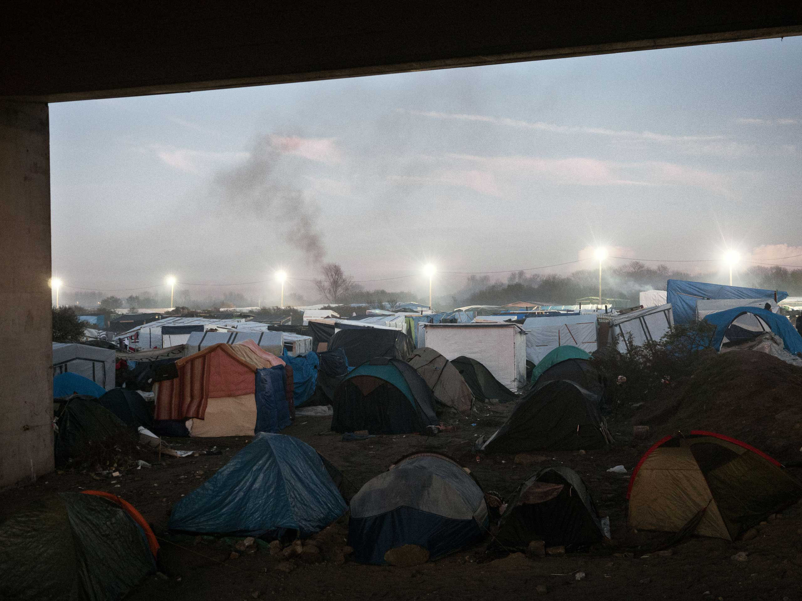 The tents that make the shantytown known as the 'jungle' of Calais, France, where a mix of refugees, asylum seekers and economic migrants from Darfur, Afghanistan, Syria, Iraq, Eritrea live before they attempt to enter the United Kingdom by stowing away on ferries, cars, or trains traveling through the Port of Calais or the Eurotunnel, Nov. 26, 2015.
