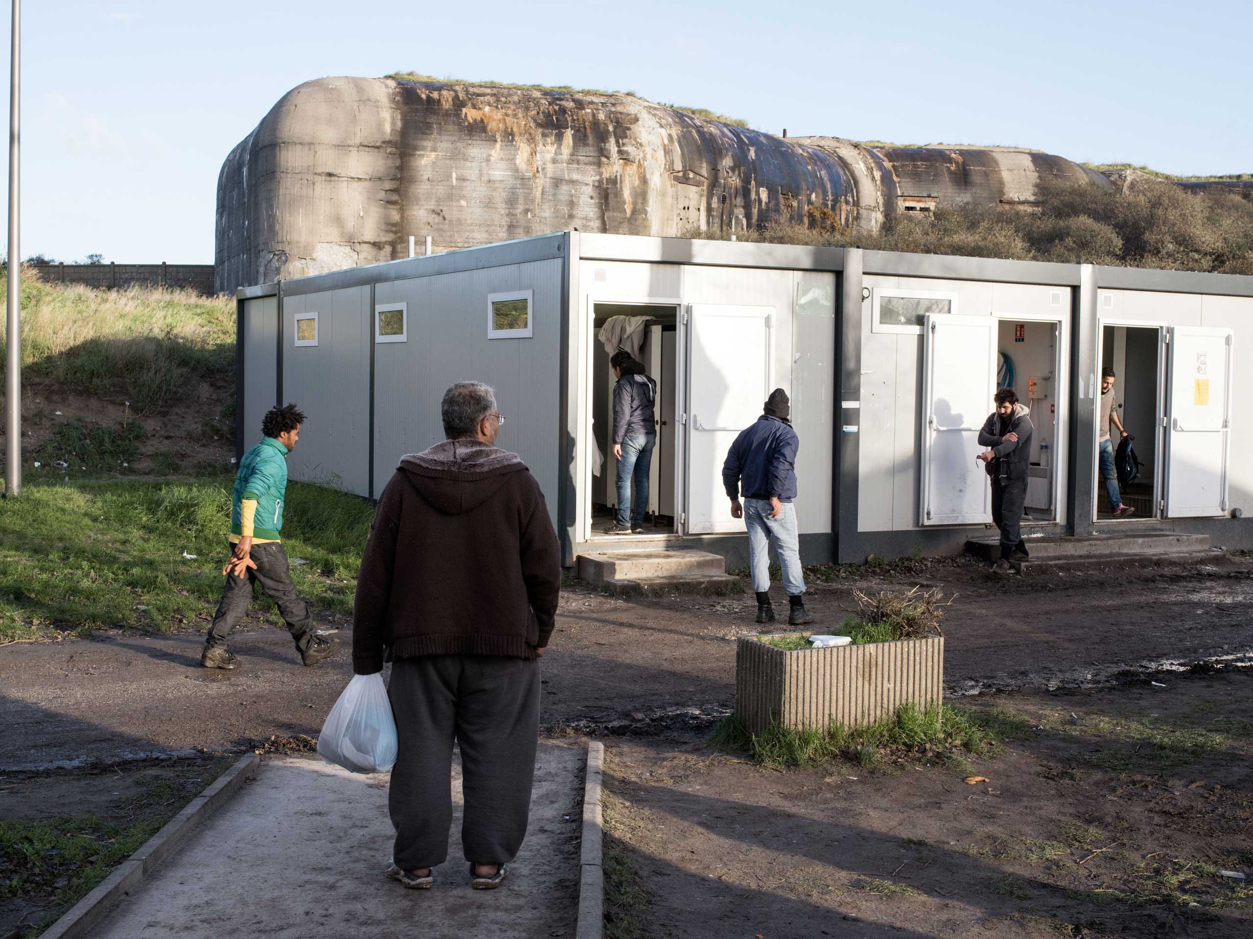 Facilities, including showers and mobile phone rechargers, are available to migrants during the day at the Jules Ferry Center in Calais, France, Nov. 25, 2015.
