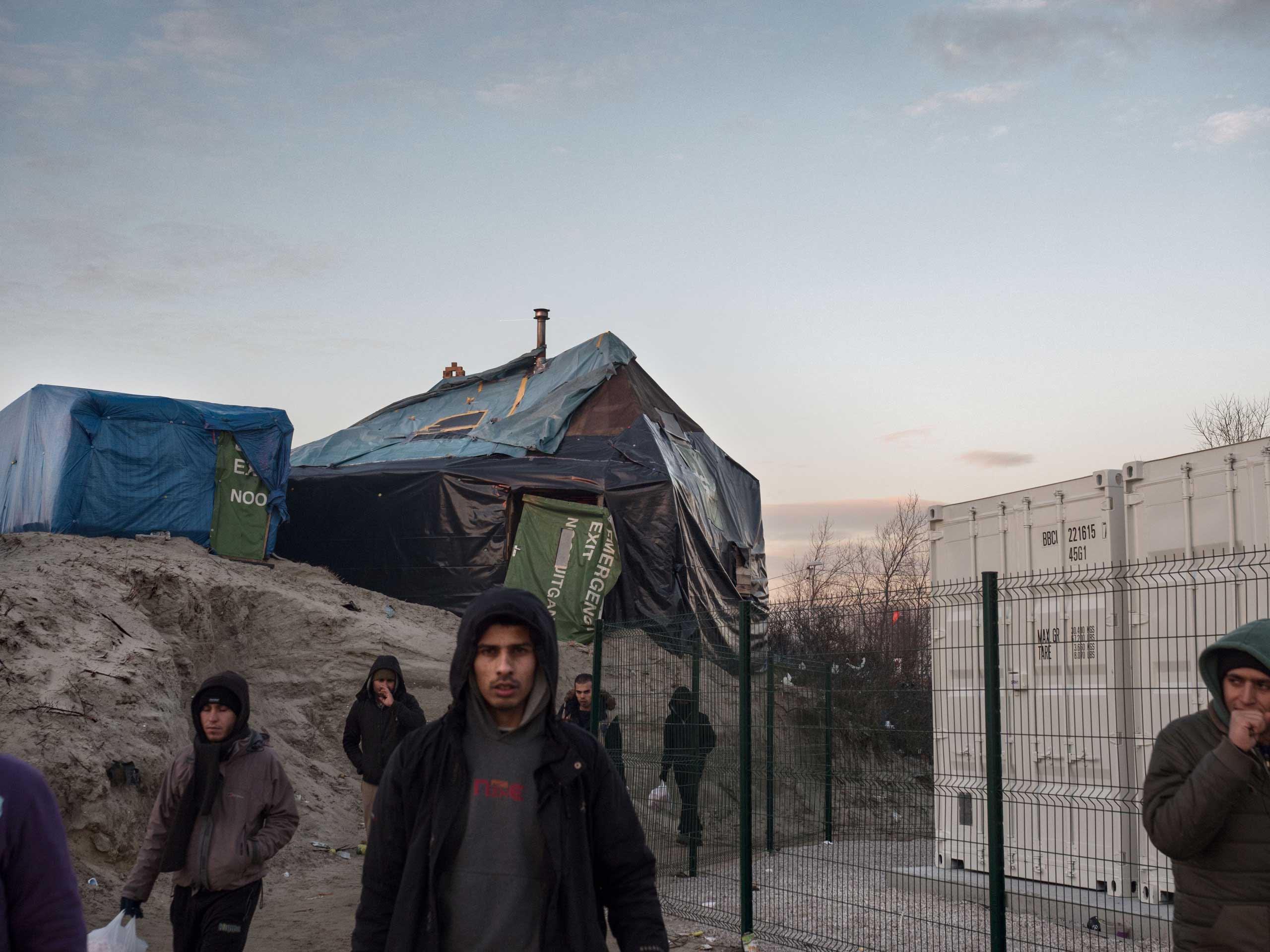 New containers for migrants are now being built that will take the place of tent dwellings in Calais, France, Jan.19, 2016.