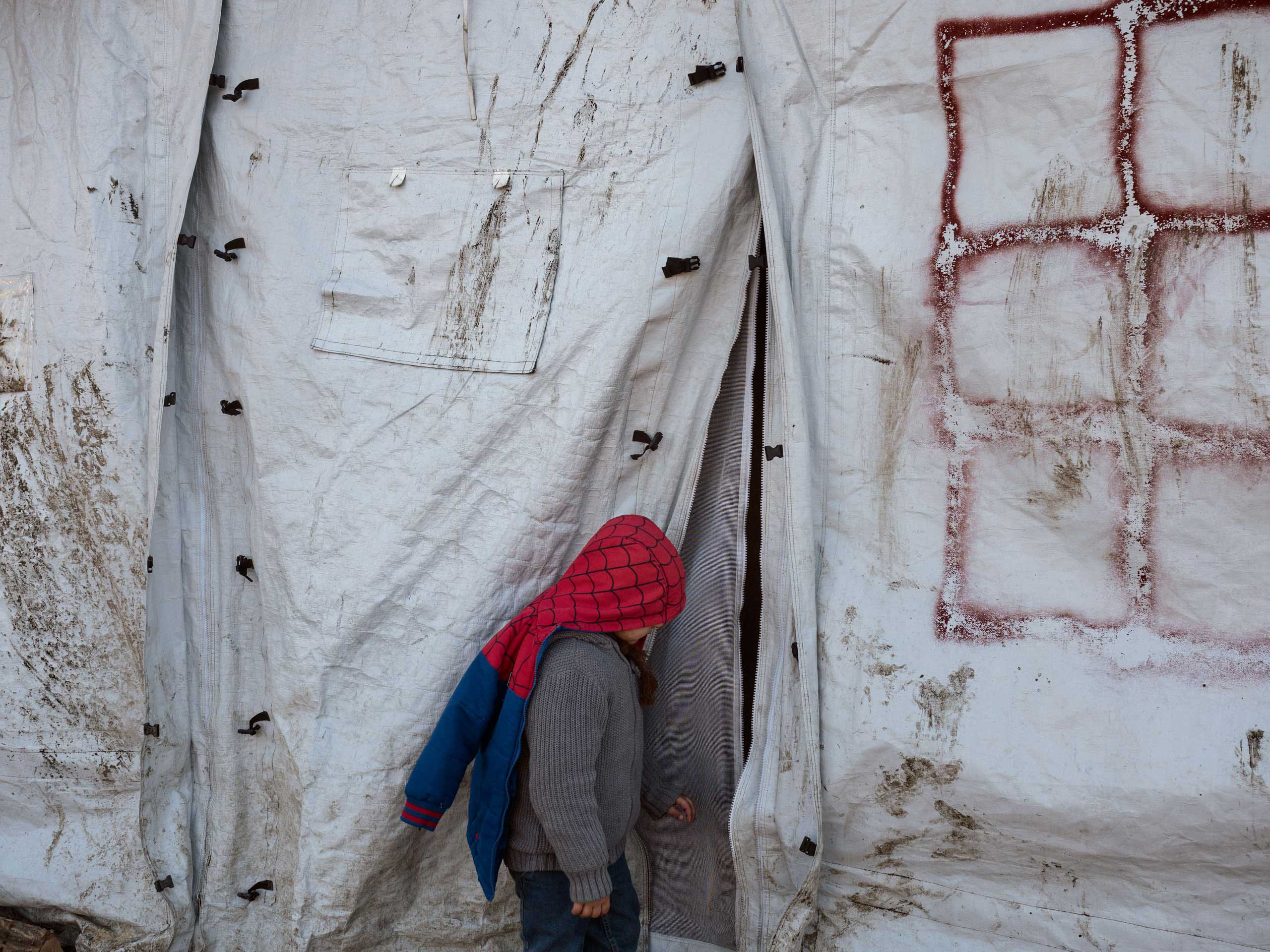 A boy wears a spider man jacket at the refugee camp in Grande-Synthe, near Dunkirk, France, which is accommodating over 2,500 refugees mostly families from Kurdistan, Jan. 19, 2016.