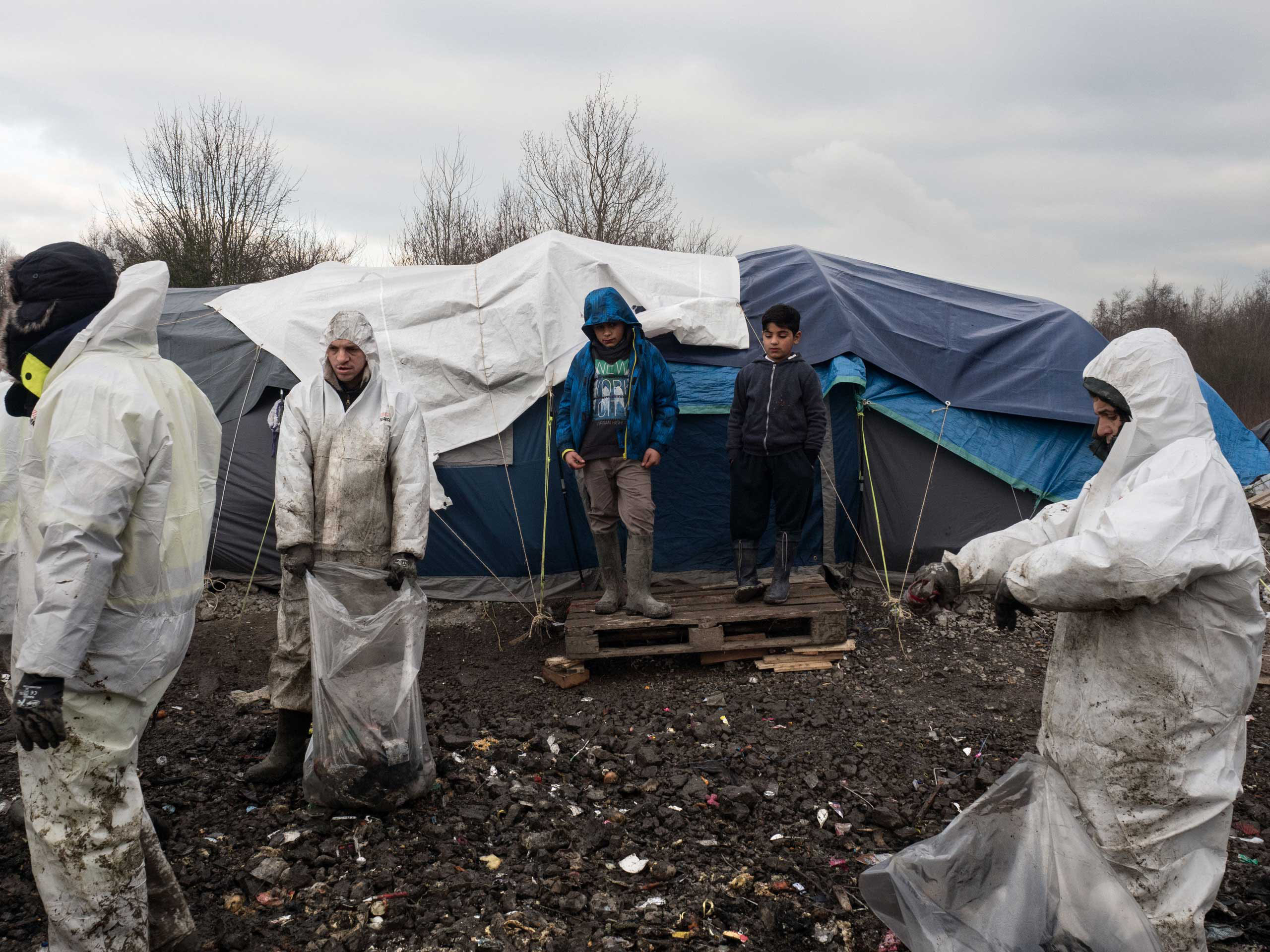 A group of workers from a private company have been hired to clean the trash left by the migrants in Grande-Synthe, the refugee camp near Dunkirk, which is accommodating over 2,500 refugees mostly families from Kurdistan, Jan. 20, 2016.