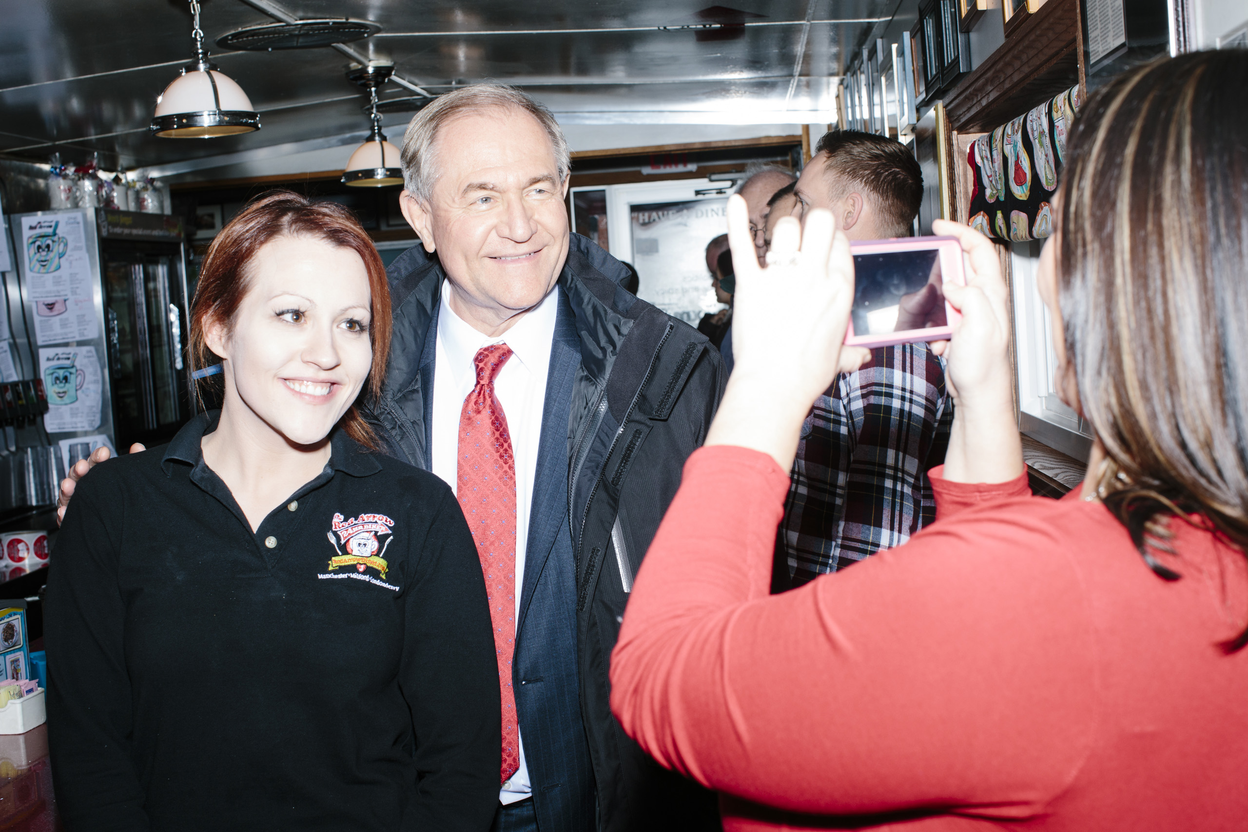 Former Virginia governor and Republican presidential candidate Jim Gilmore poses for a picture with general manager Jayme Lemay, of Nashua, NH, at the Red Arrow Diner in Manchester, New Hampshire, on Mon., Feb. 8, 2016. The Red Arrow Diner is a frequent stop of political candidates. Sirius XM was broadcasting live from the diner Monday and Tuesday.