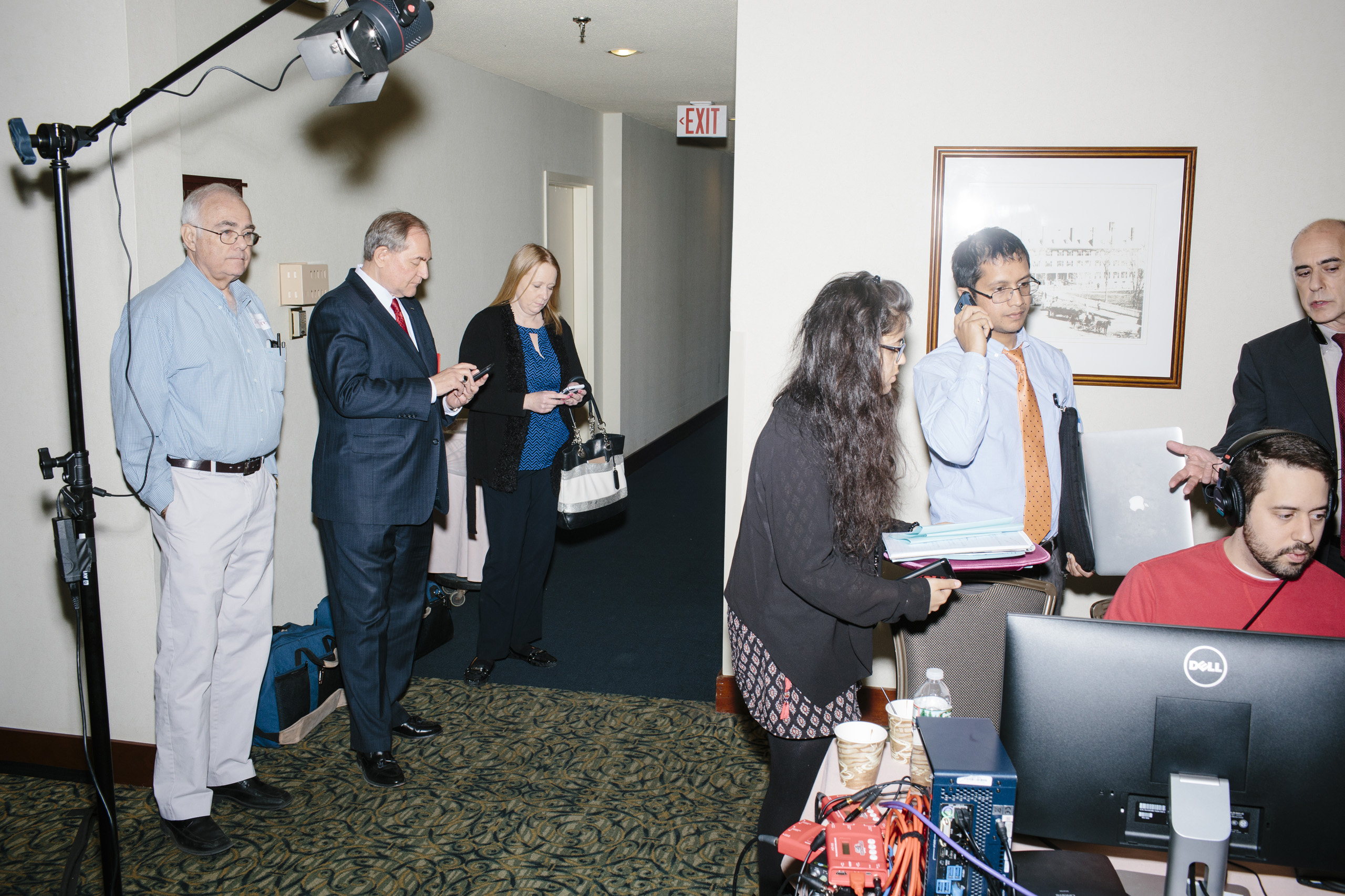 Former Virginia governor and Republican presidential candidate Jim Gilmore waits for an interview with TheRealNews.com at the Radisson Hotel's Radio Row in Manchester, New Hampshire, on Mon., Feb. 8, 2016. Also pictured is Gilmore's NH state director Anne Smith, of Bedford, NH, (blond, center) and Gilmore's brother-in-law, Lloyd Gatling, of Suffolk, Virginia (left). Many television and radio stations set up in the hotel for their coverage of the primary in the final days of the campaign.
