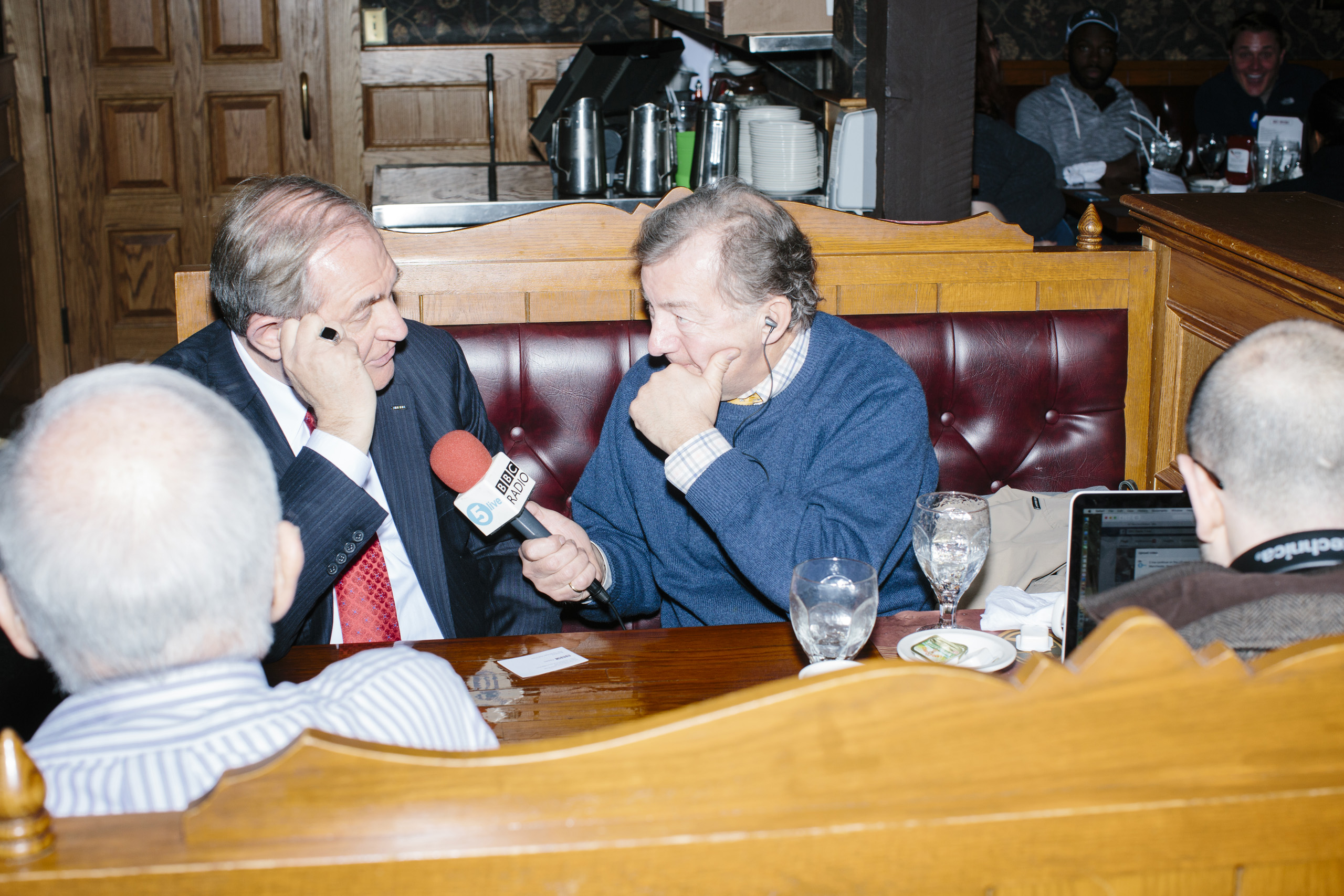 BBC 5 reporter Rhod Sharp interviews former Virginia governor and Republican presidential candidate Jim Gilmore before he gets lunch at the Puritan Backroom on the day of primary voting, Feb. 9, 2016. Sharp's radio program is called  Up All Night.  The Puritan Backroom is a long-time favorite stop of political candidates in the state and place where journalists and political junkies hang out on election days hoping to meet candidates.