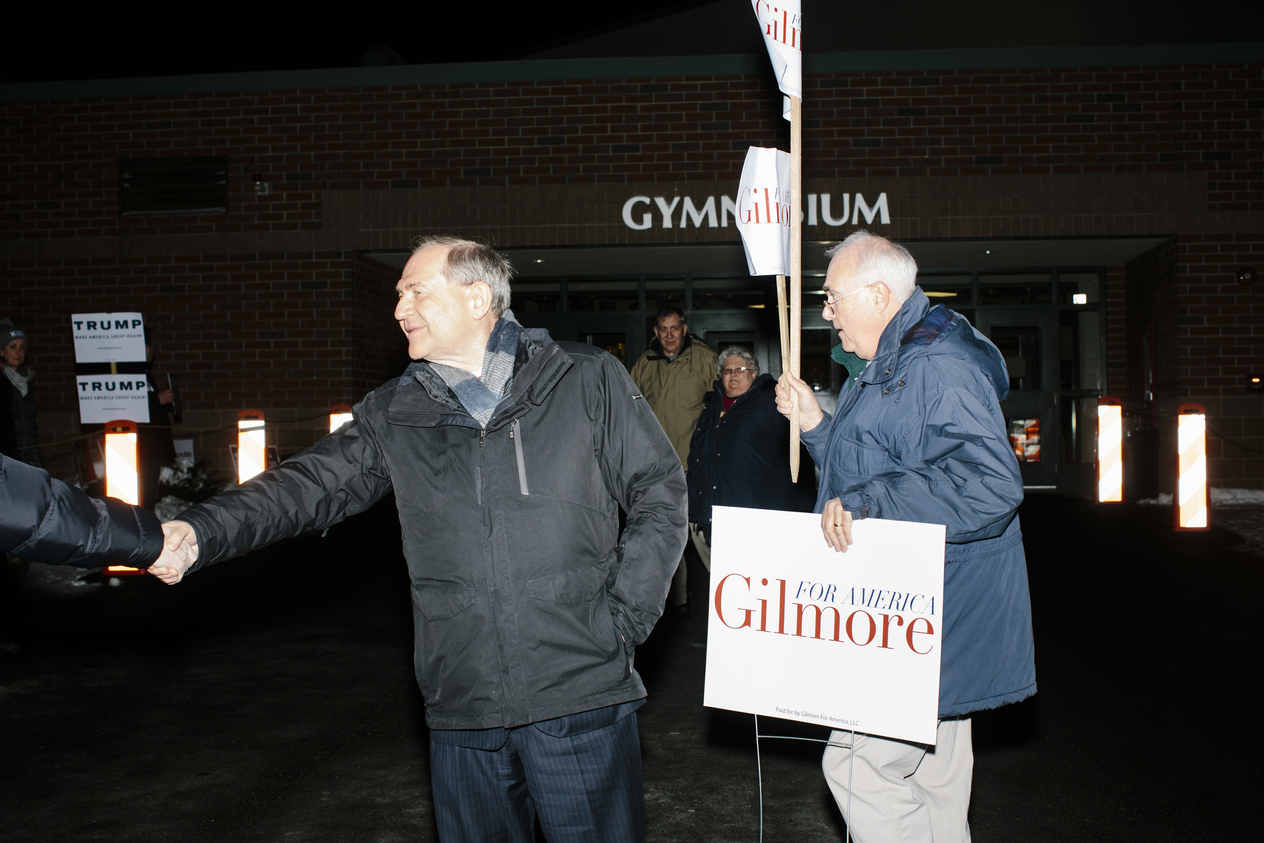 Former Virginia governor and Republican presidential candidate Jim Gilmore greets people outside the polling station at Bedford High School in Bedford New Hampshire, on the day of primary voting, Feb. 9, 2016.