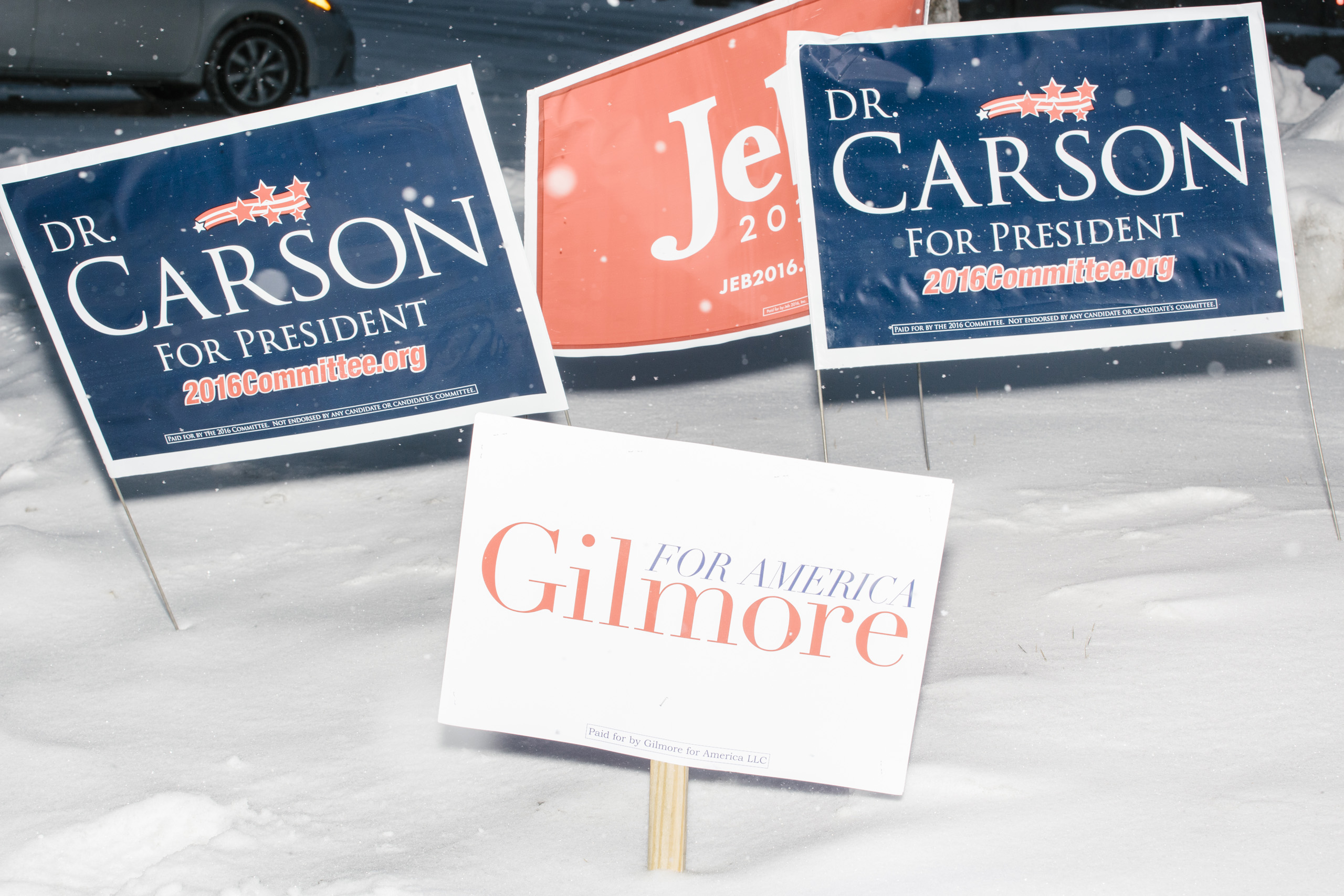 A campaign sign for former Virginia governor and Republican presidential candidate Jim Gilmore stands in the snow among those of other Republican presidential candidates on Granite Street in Manchester, New Hampshire, on Mon., Feb. 8, 2016.