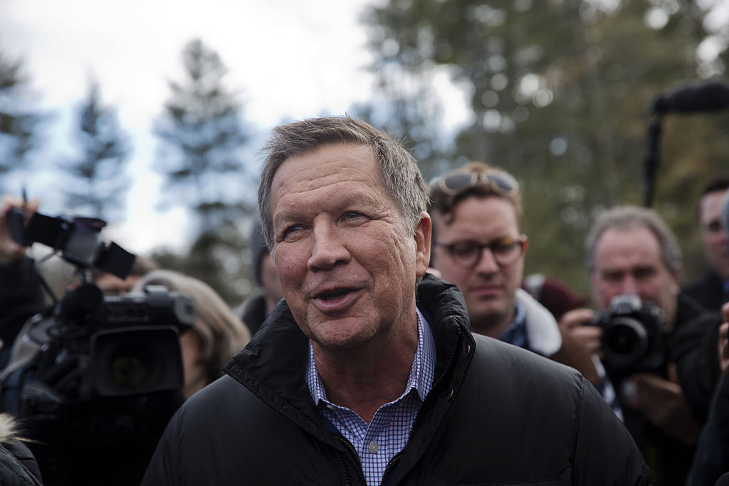 John Kasich, governor of Ohio and 2016 Republican presidential candidate, greets voters while arriving at a polling station at Broken Gound Elementary School in Concord, New Hampshire.
