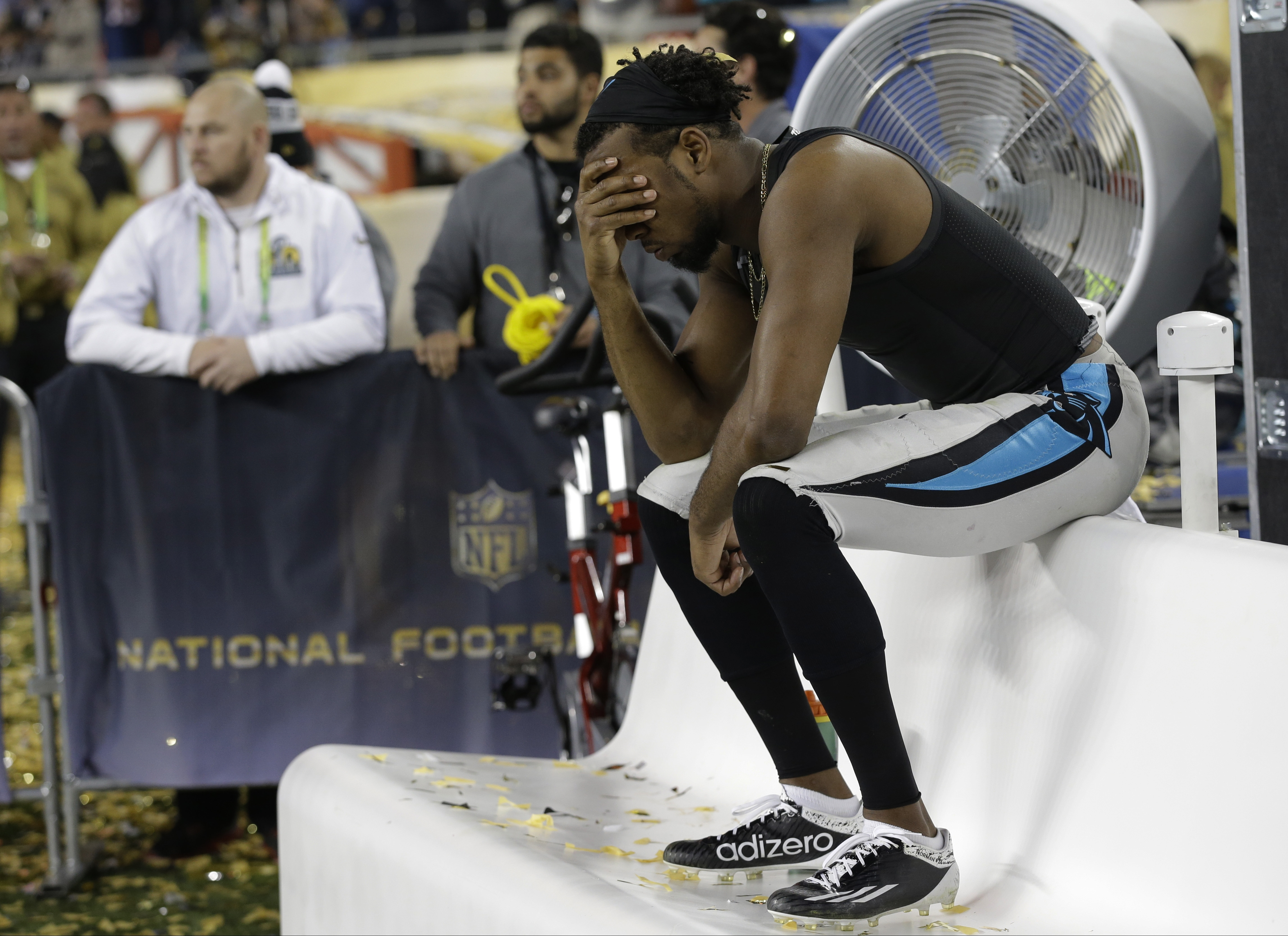 Carolina Panthers' Josh Norman (24) sits on the bench after the NFL Super Bowl 50 football game against the Denver Broncos Sunday in Santa Clara, Calif., on Feb. 7, 2016.