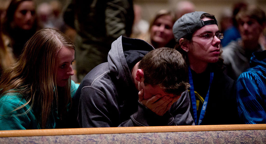 People gather and pray at Center Point Church following a mass shooting on February 21, 2016 in Kalamazoo, Michigan.