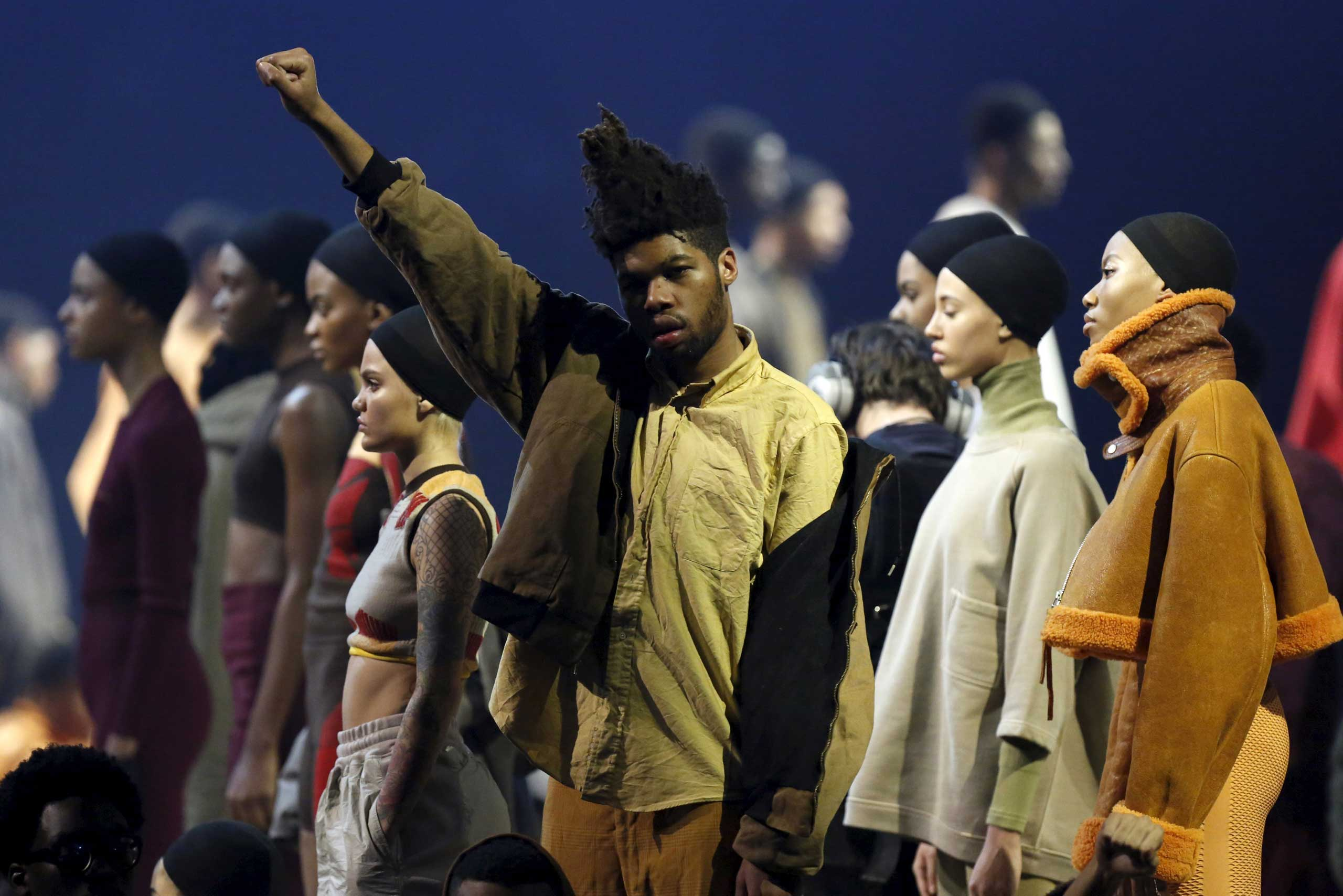 Models present creations at Kanye West's Yeezy Season 3 fashion show while listening to the artist's latest album  The Life of Pablo  at Madison Square Garden, Feb. 11, 2016.