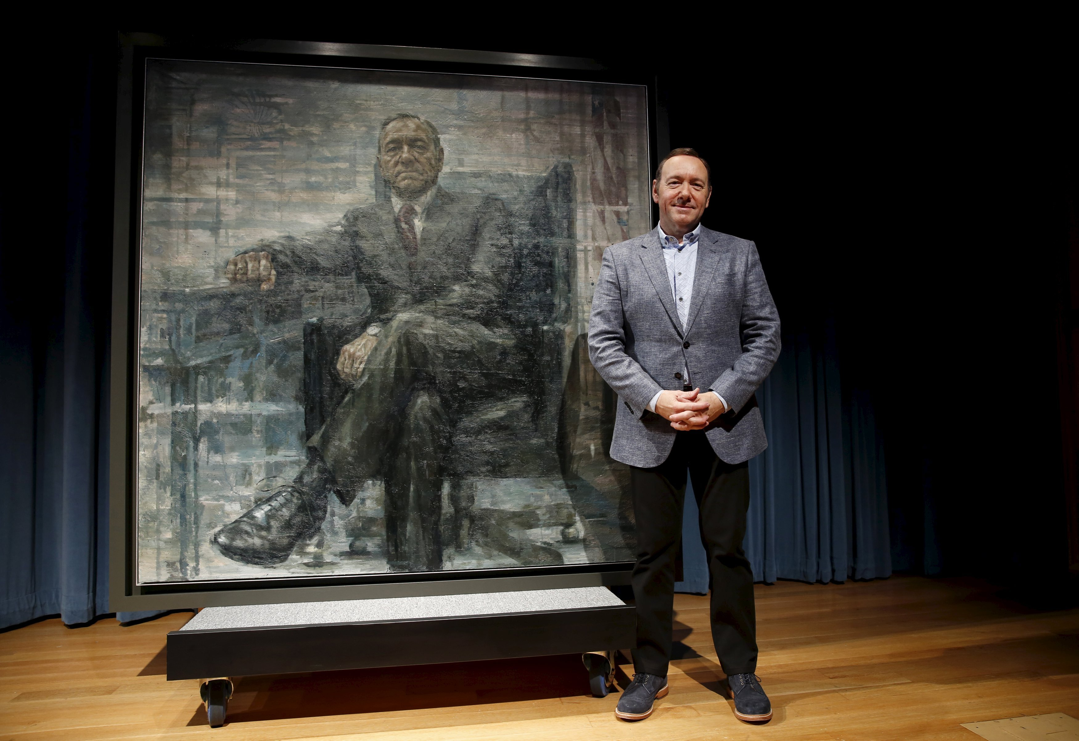 Actor Kevin Spacey stands beside a portrait of his House of Cards character President Frank J. Underwood on the  day of its unveiling at the Smithsonian's National Portrait Gallery in Washington, Feb. 22, 2016.