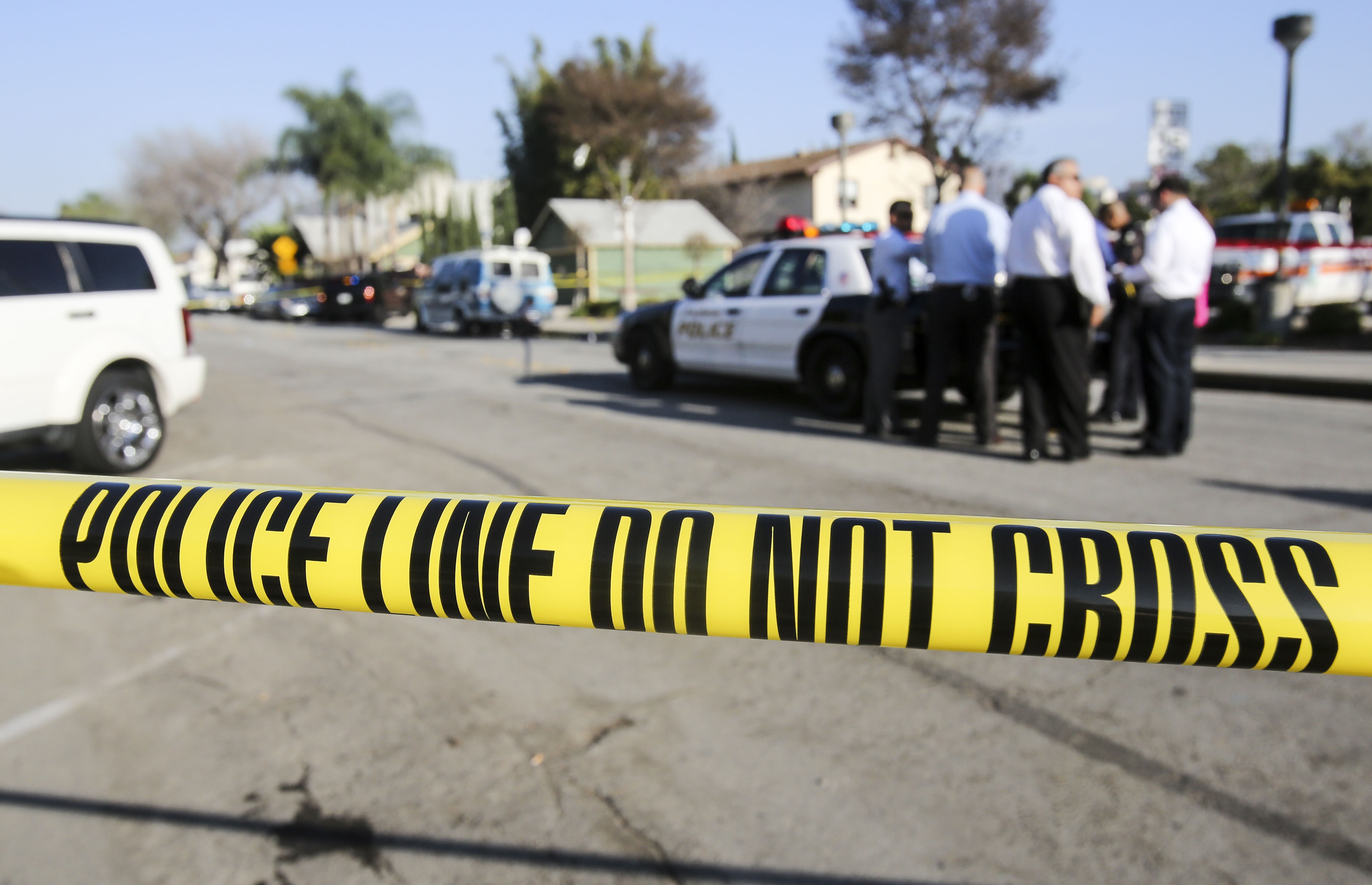 Police officers investigate the scene near Pearson Park in Anaheim, California,  February 27, 2016, after three counter-protesters were stabbed while clashing with Ku Klux Klan members staging a rally.