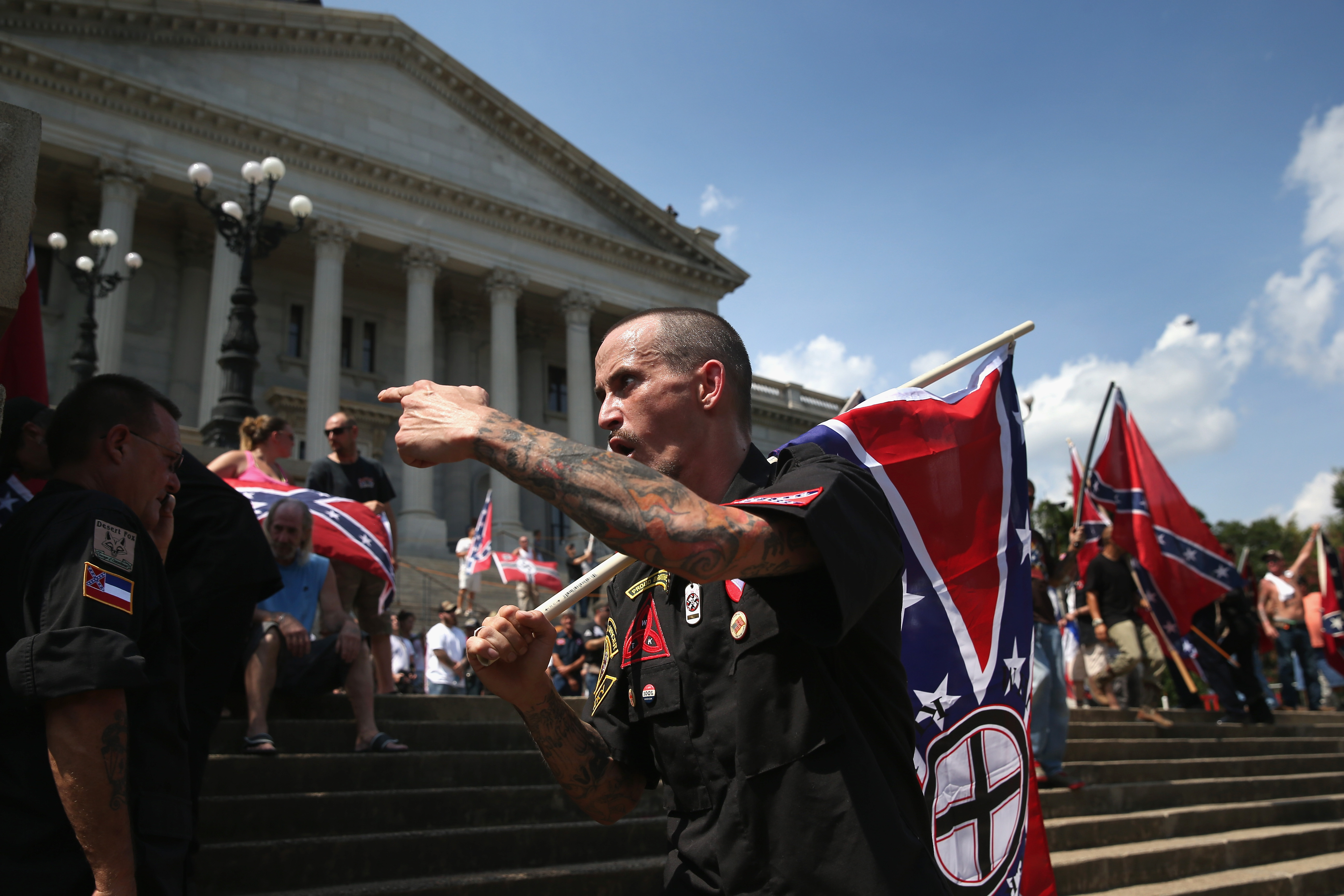 Counter protesters and Ku Klux Klan members argue at a Klan demonstration at the state house building  in Columbia, SC on July 18, 2015.
