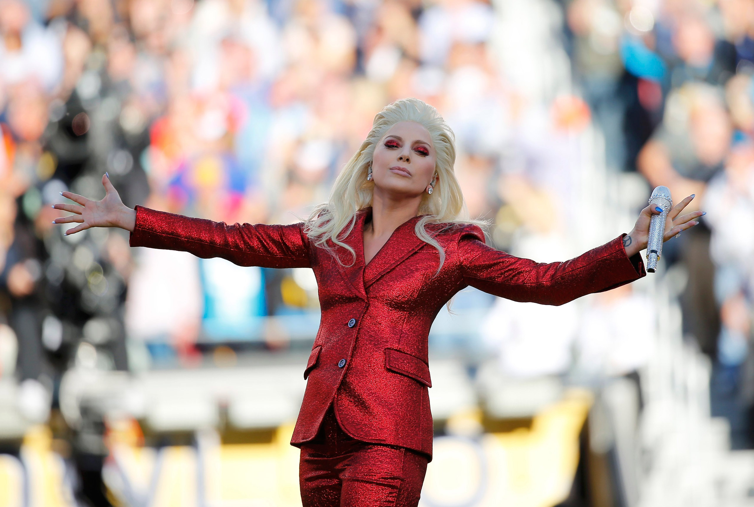 Lady Gaga sings the U.S. National Anthem before the start of the NFL's Super Bowl 50 between the Carolina Panthers and the Denver Broncos in Santa Clara, California Feb. 7, 2016.