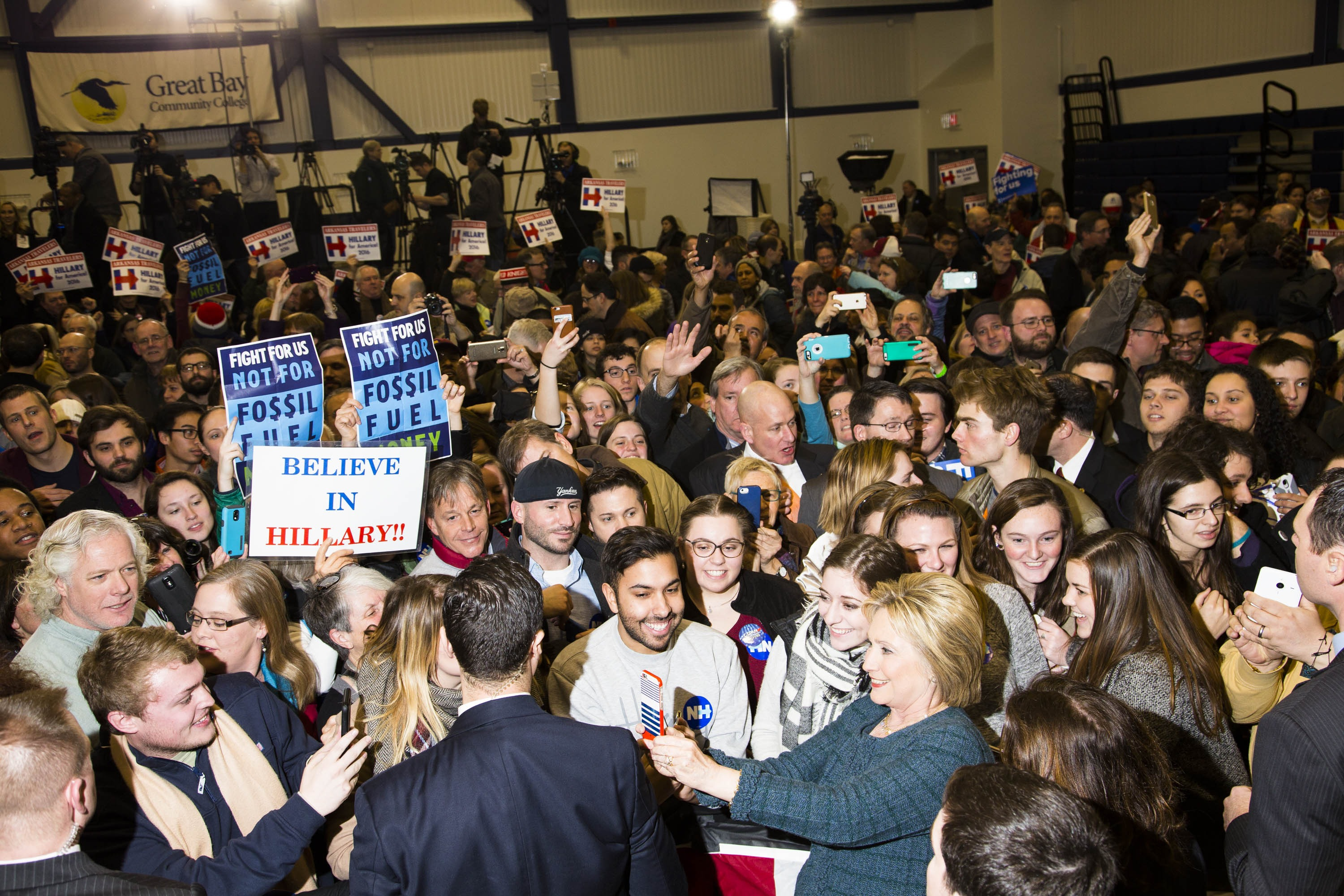 Democratic presidential candidate, former Secretary of State Hillary Clinton takes a selfie with supporters during a campaign event at Great Bay Community College on Saturday, Feb. 6, 2016, in Portsmouth, N.H.