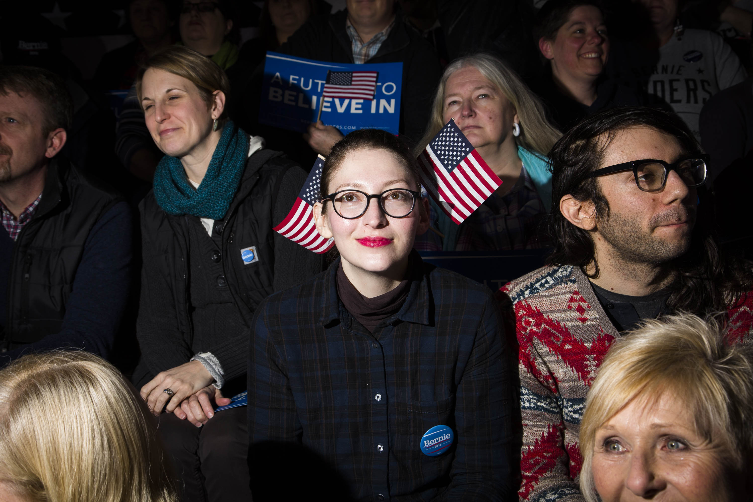 Anjuli Willmer sports double flags at a New Hampshire primary night rally for Democratic presidential candidate, Vermont Sen. Bernie Sanders at Concord High School on Tuesday, Feb.  9, 2016, in Concord, N.H.