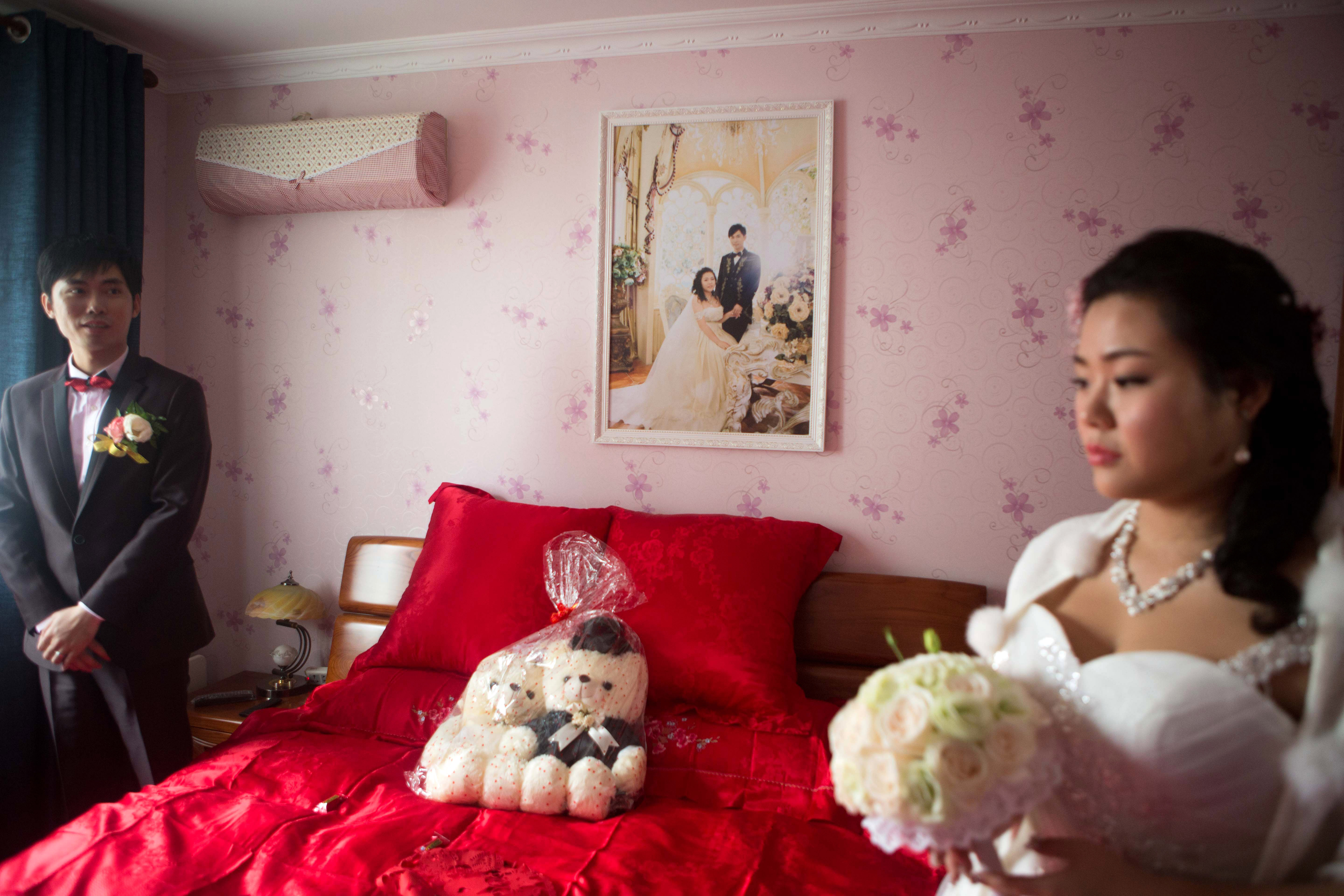 A pre-wedding photo hangs on the wall at the future apartment of Xia Jiachen and Xu Chuyun in December 2015. They visit the apartment during their wedding ceremony.